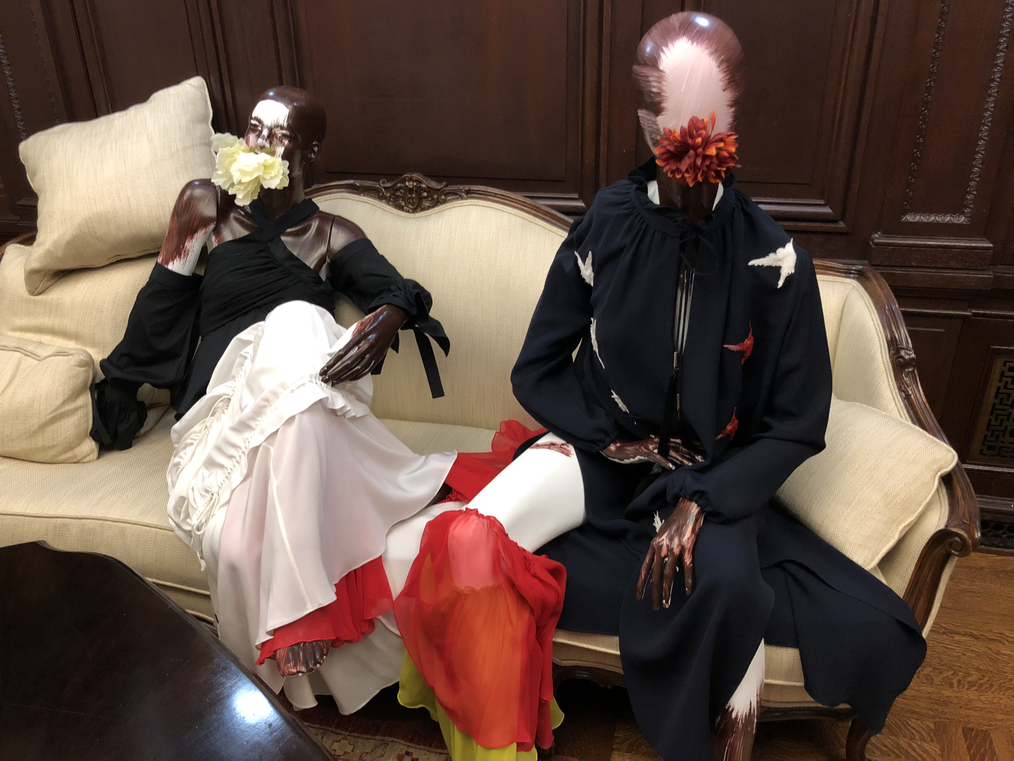 Two outfits from Azede Jean-Pierre's collection on display at the Haitian Embassy in Washington D.C. during a fashion event, Feb. 23, 2018. (Photo: S. Lemaire / VOA)