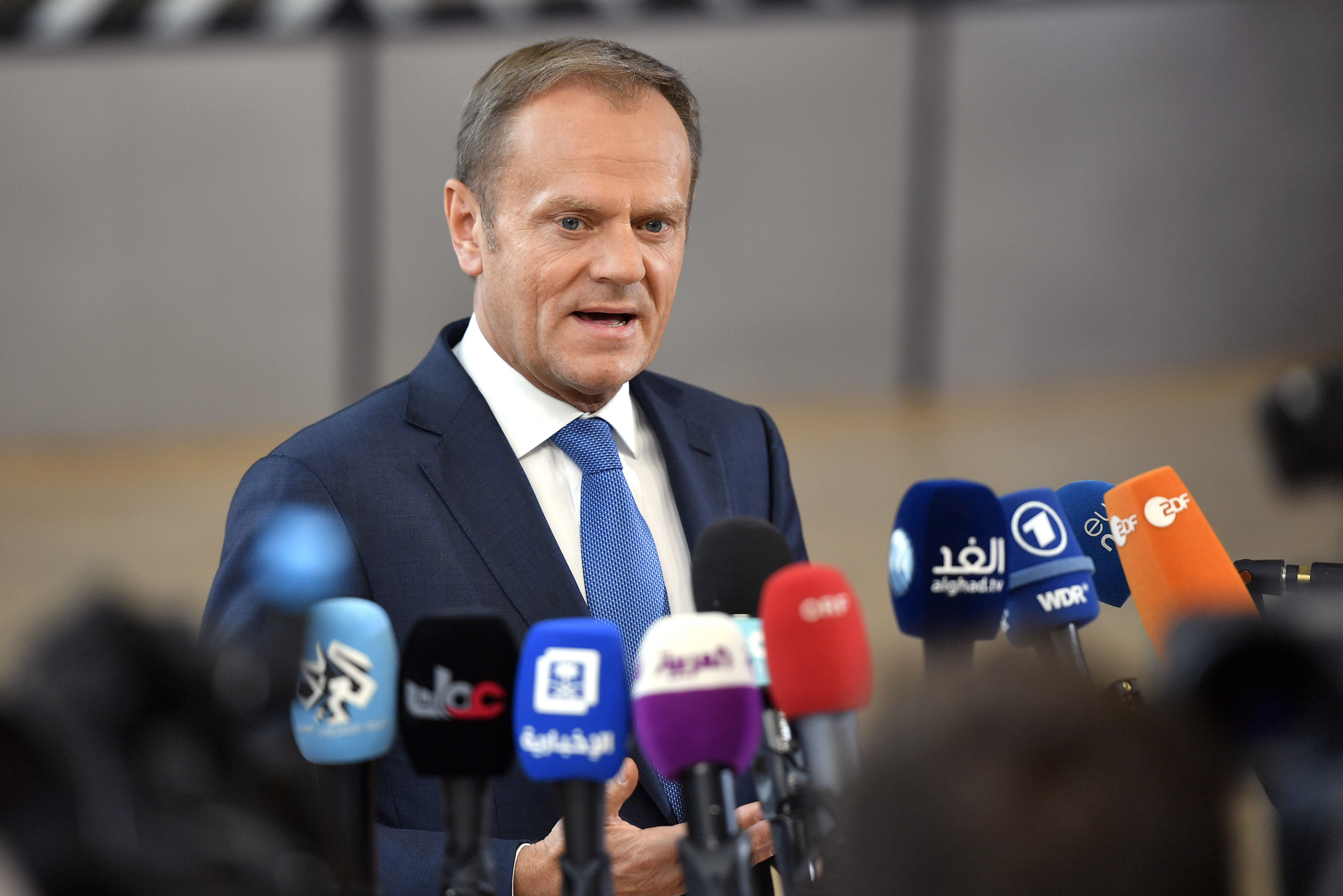 European Council President Donald Tusk speaks with the media as he arrives for an EU summit at the Europa building in Brussels, Belgium, April 29, 2017.