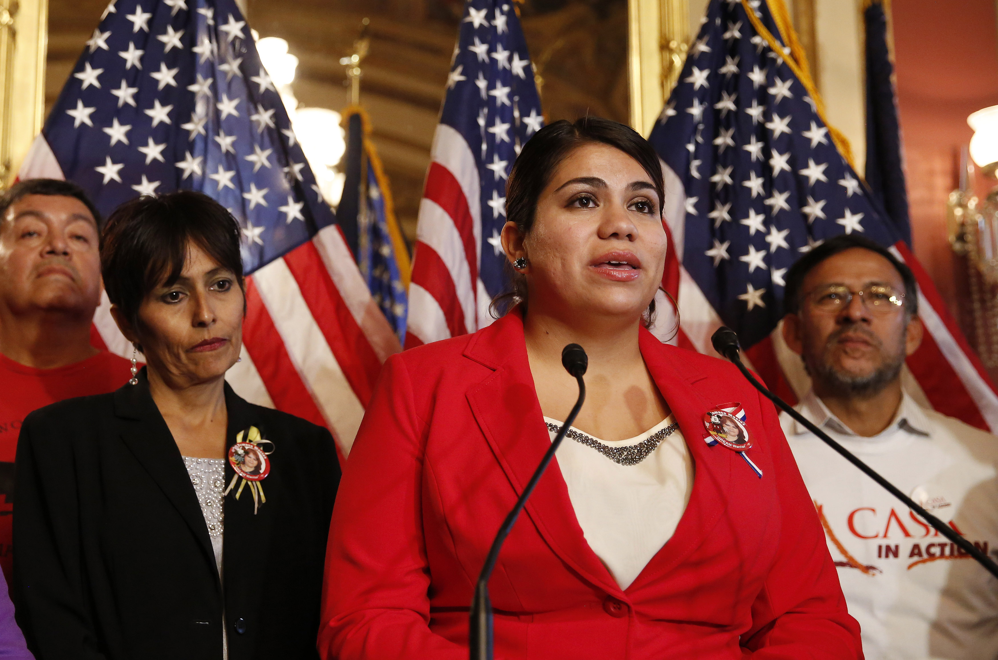 FILE - Immigration activist Astrid Silva (in red) stands next to her mother, Barbara Silva, as she speaks about immigration reform at a news conference on Capitol Hill in Washington, Dec. 10, 2014. Astrid Silva will be one of the speakers on the open...