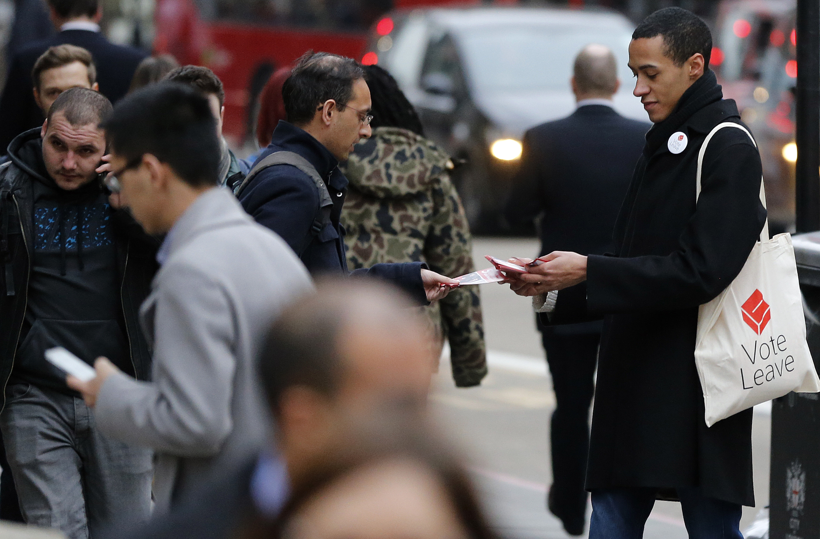 A pro-Brexit campaigner hands out leaflets at Liverpool Street station in London, March 23, 2016. EU officials warn that Britain would be the bigger loser should it decite to leave the bloc.