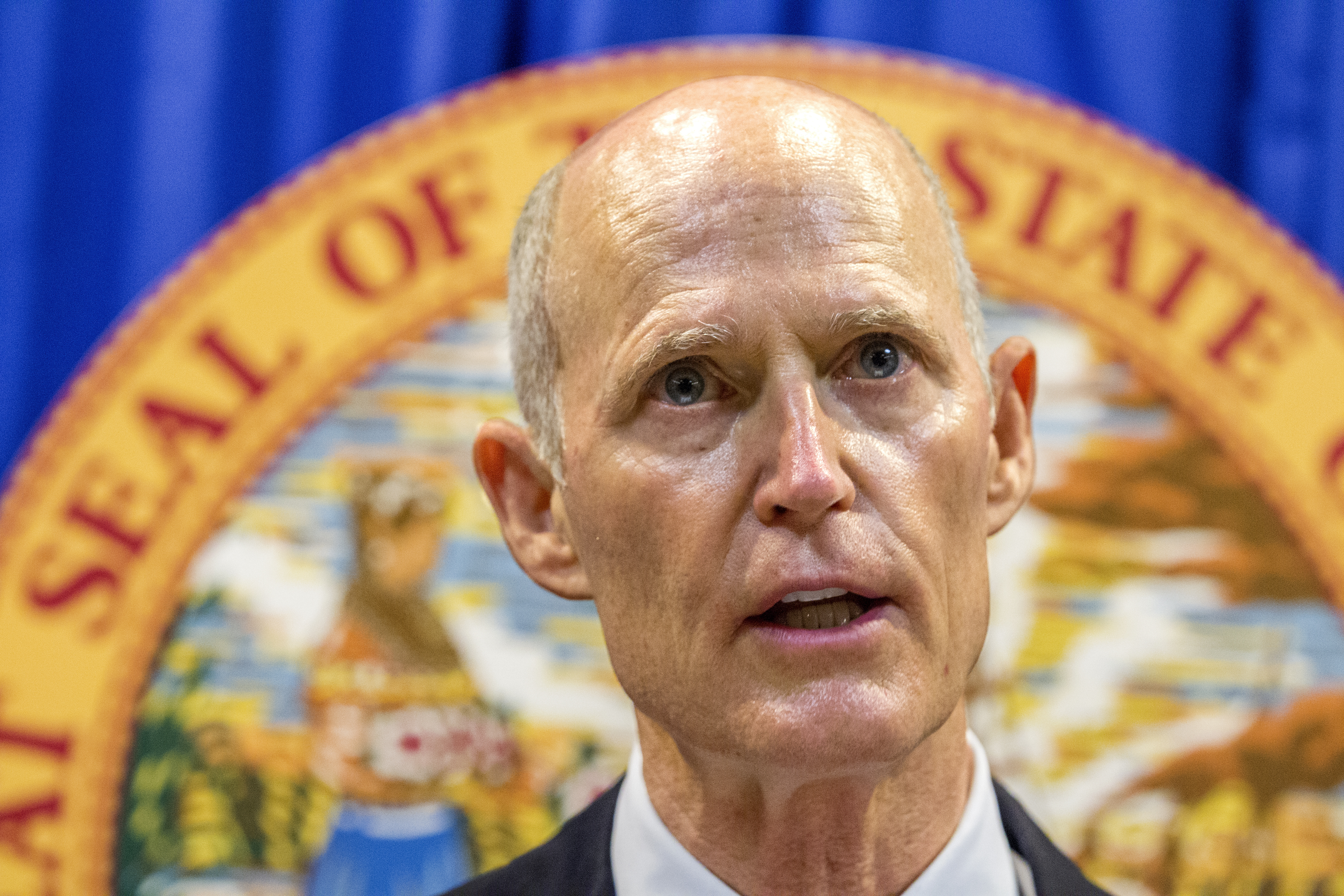 Florida Governor Rick Scott lays out his school safety proposal during a press conference at the Florida Capitol in Tallahassee, Fla.,  Feb. 23, 2018. Scott proposed banning the sale of firearms to anyone younger than 21 as part of a plan to prevent ...