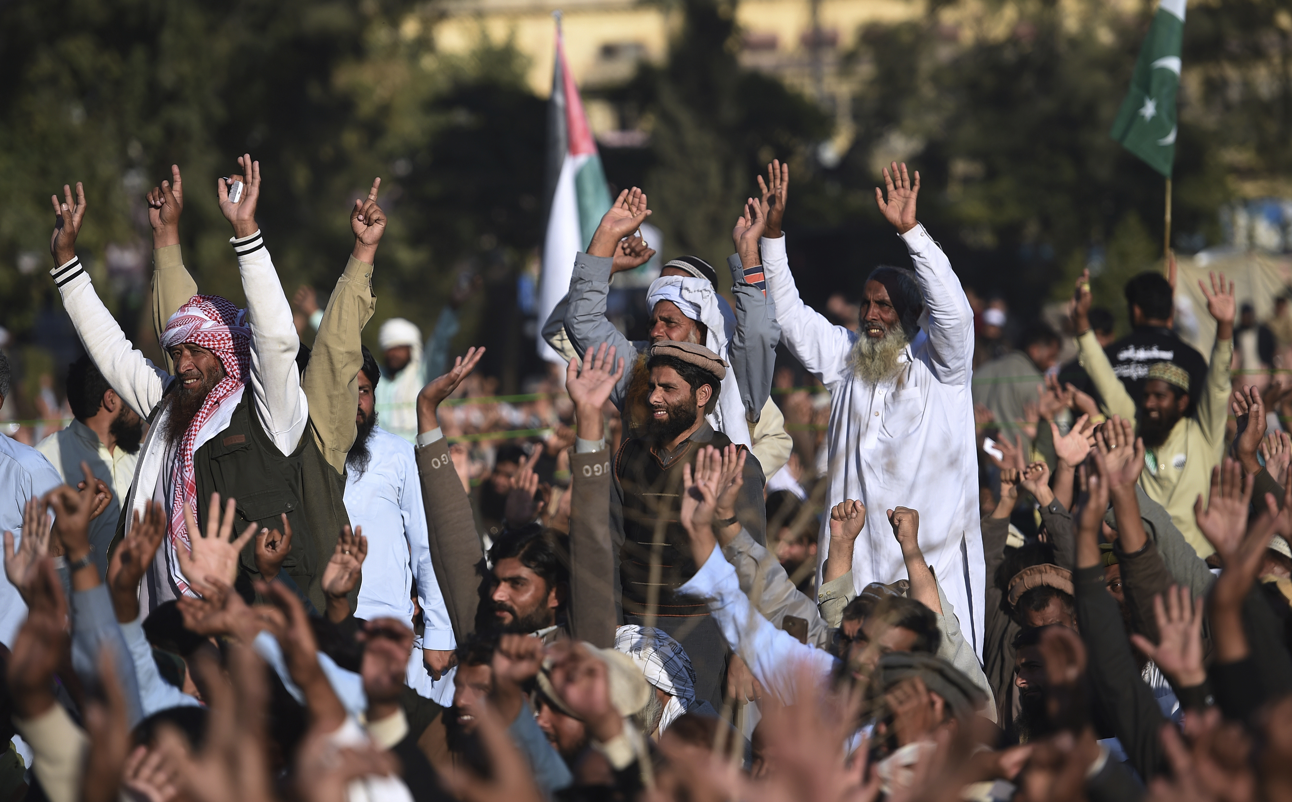 Supporters of the Pakistan Defense Council chant slogans at a rally against America, in Rawalpindi, Pakistan, Dec. 29, 2017. The Palestinian envoy attended the rally with Hafiz Saeed, the head of the hard-line Jamaat-ud-Dawa movement and a suspected ...