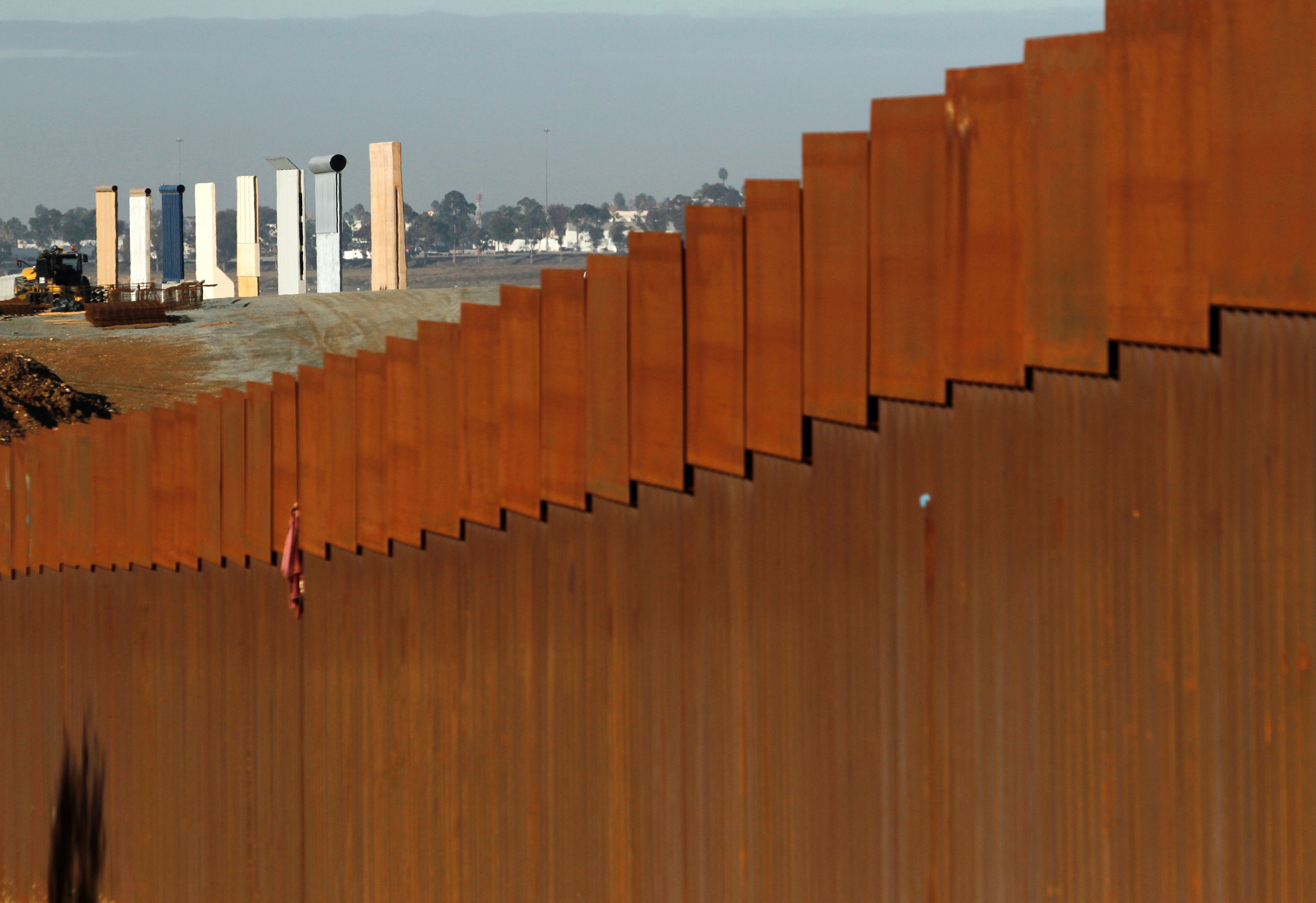 The prototypes for U.S. President Donald Trump's border wall are seen behind the border fence between Mexico and the United States, in Tijuana, Mexico, Jan. 7, 2019.