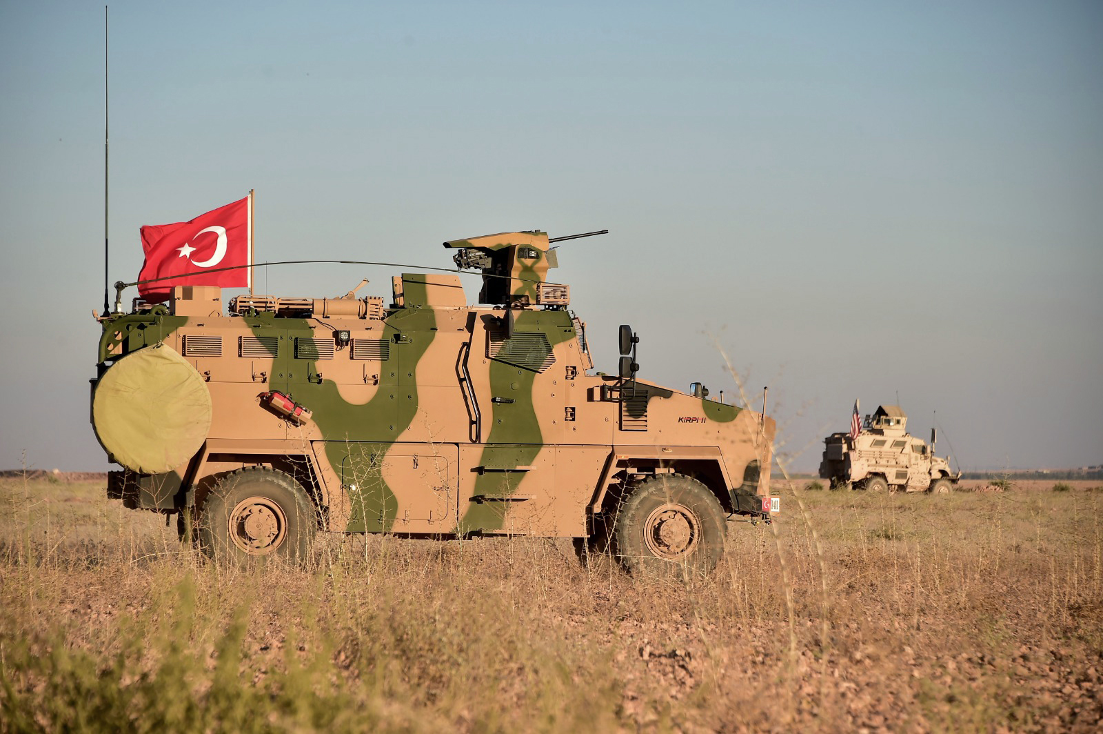 FILE - Turkish and U.S. troops conduct joint patrols around the Syrian town of Manbij, as part of an agreement that aimed to ease tensions between the two NATO allies, Nov. 1, 2018.