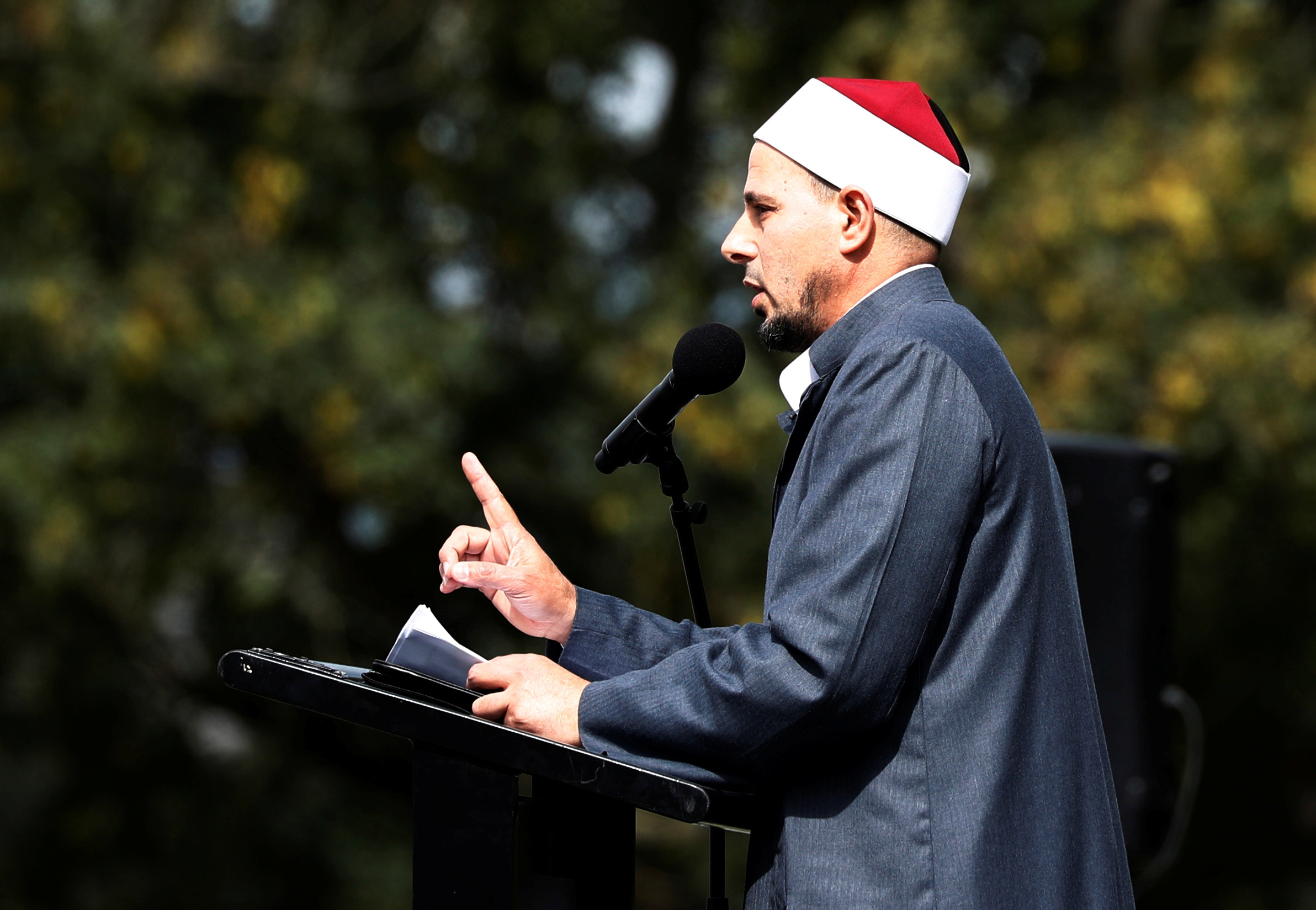 Imam Gamal Fouda leads a Friday prayer at Hagley Park outside al-Noor mosque in Christchurch, New Zealand, March 22, 2019.