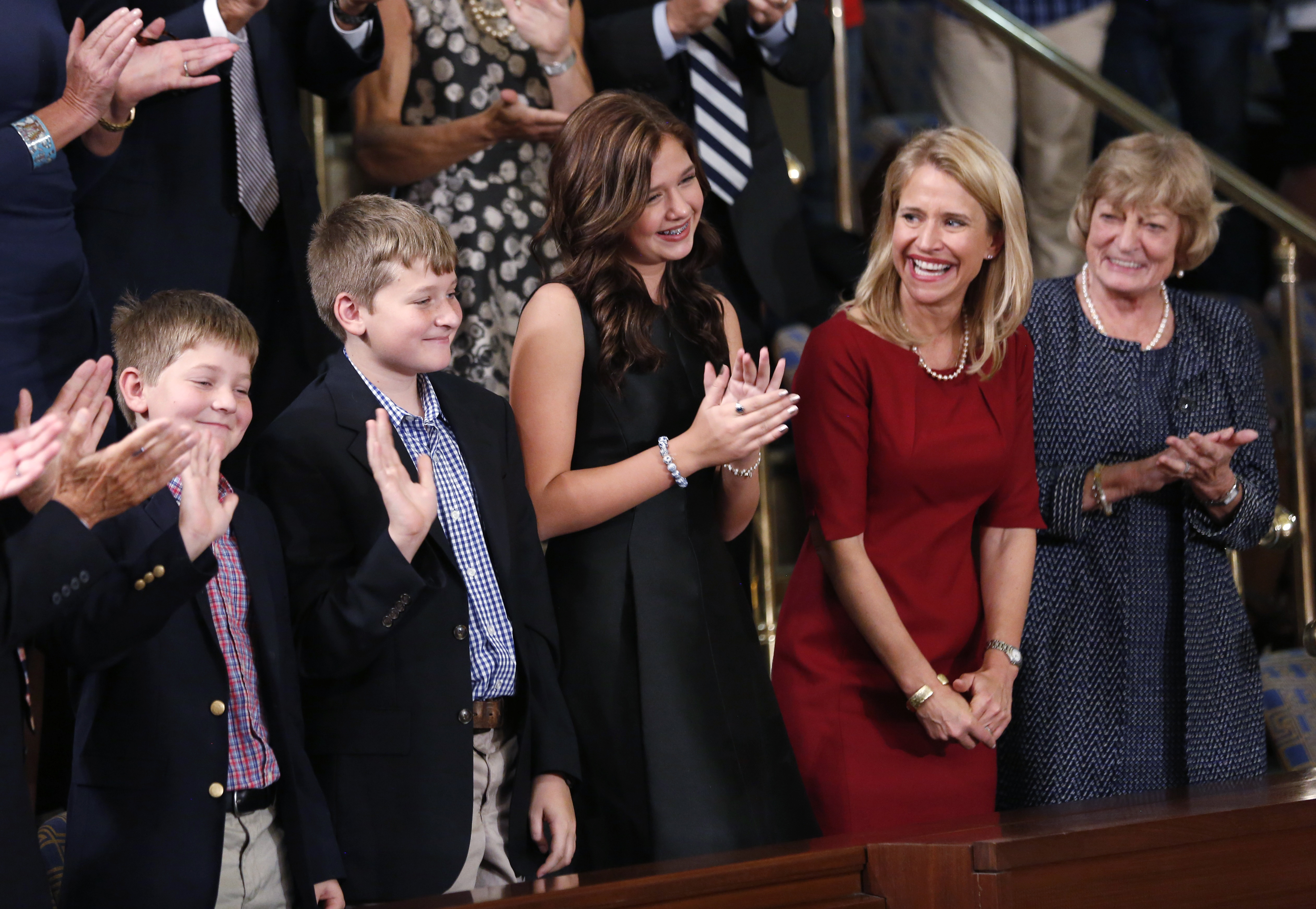 U.S. House Speaker Paul Ryan's family, from left, sons Sam and Charlie, daughter Liza, wife Janna and mother Elizabeth, wave to him from the gallery during the election in the House Chamber in Washington, Oct. 29, 2015.