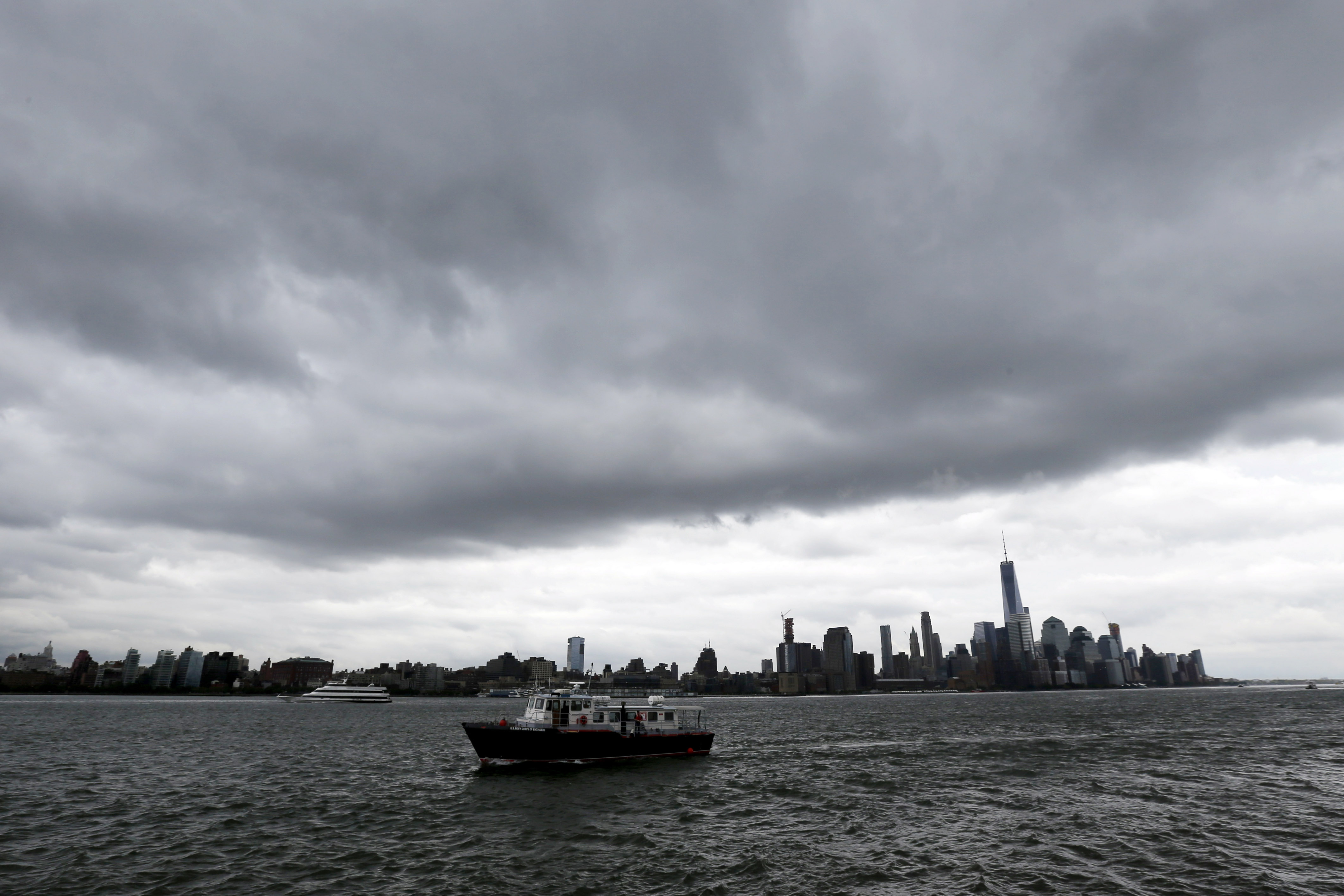 A boat passes Pier A Park on the Hudson River with the New York skyline in the background, Sept. 30, 2015. Officials along the Eastern Seaboard are taking precautions for the rest of the week as forecasters closely follow Hurricane Joaquin.
