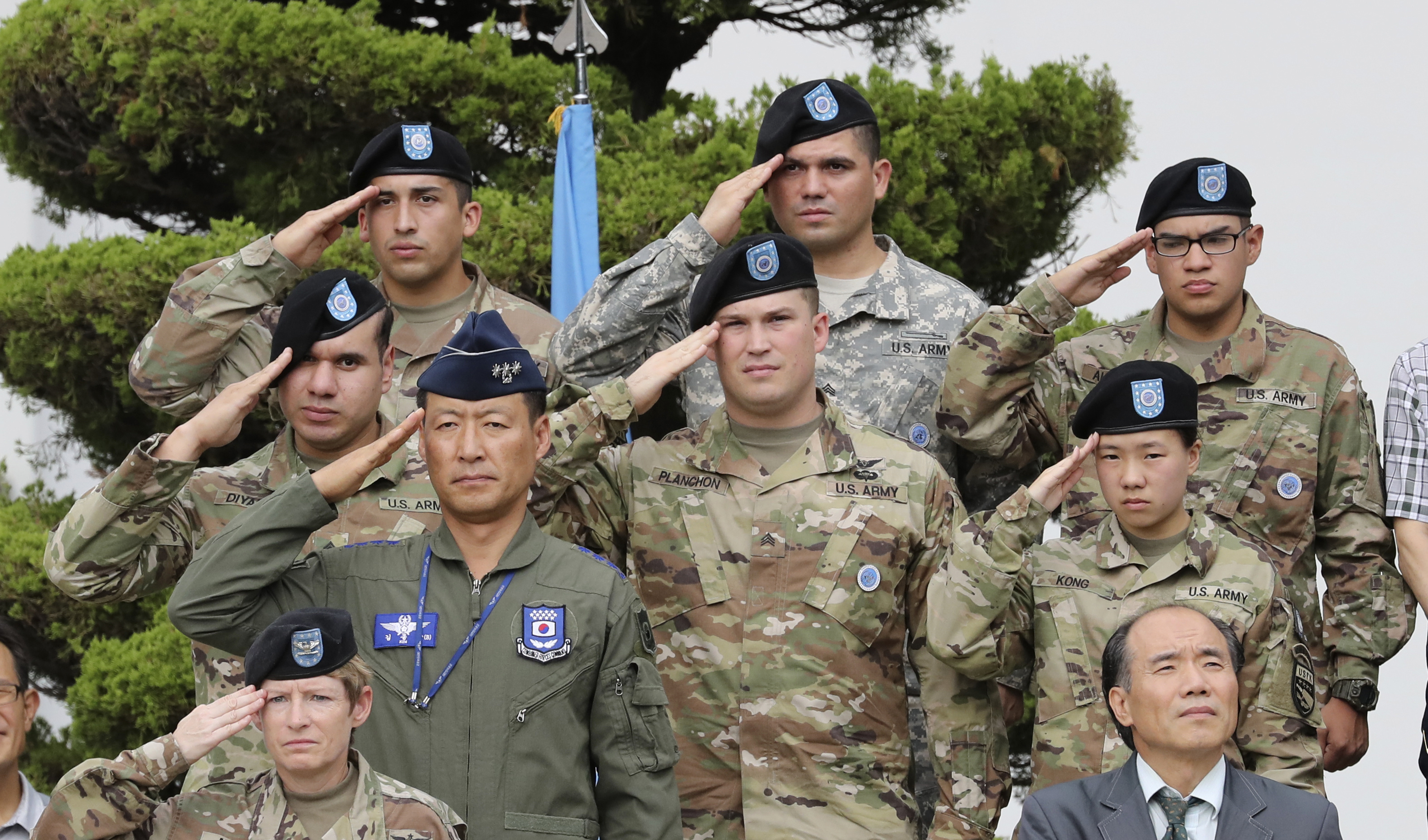 U.S. and South Korean soldiers salute during a change of command and responsibility ceremony at Yongsan Garrison, a U.S. military base, in Seoul, South Korea,  Aug. 11, 2017.