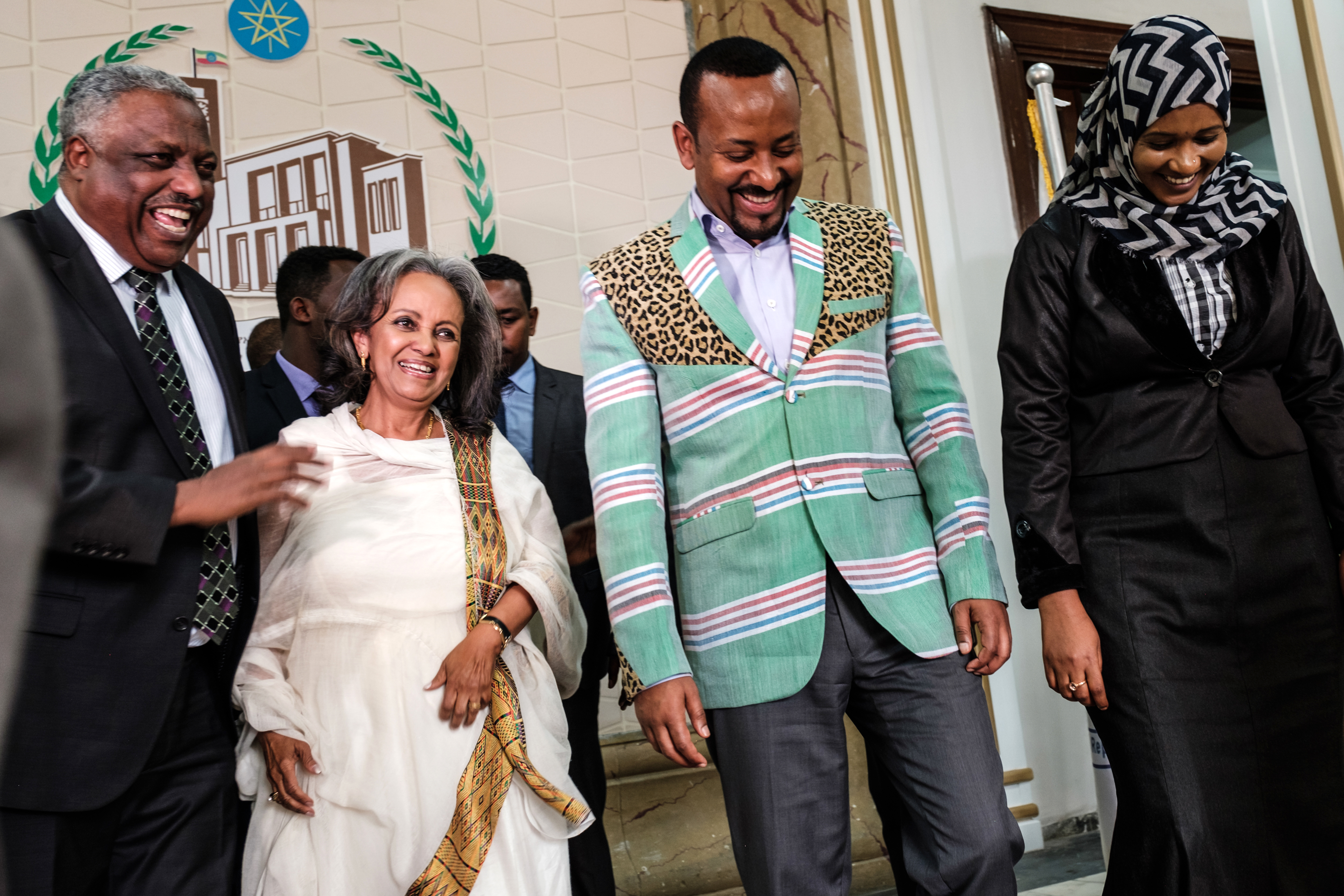 Sahle-Work Zewde (2-L) walks with Prime Minister Abiy Ahmed (2-R) after being elected Ethiopia's first female president, at the Parliament in Addis Ababa, Oct. 25, 2018.