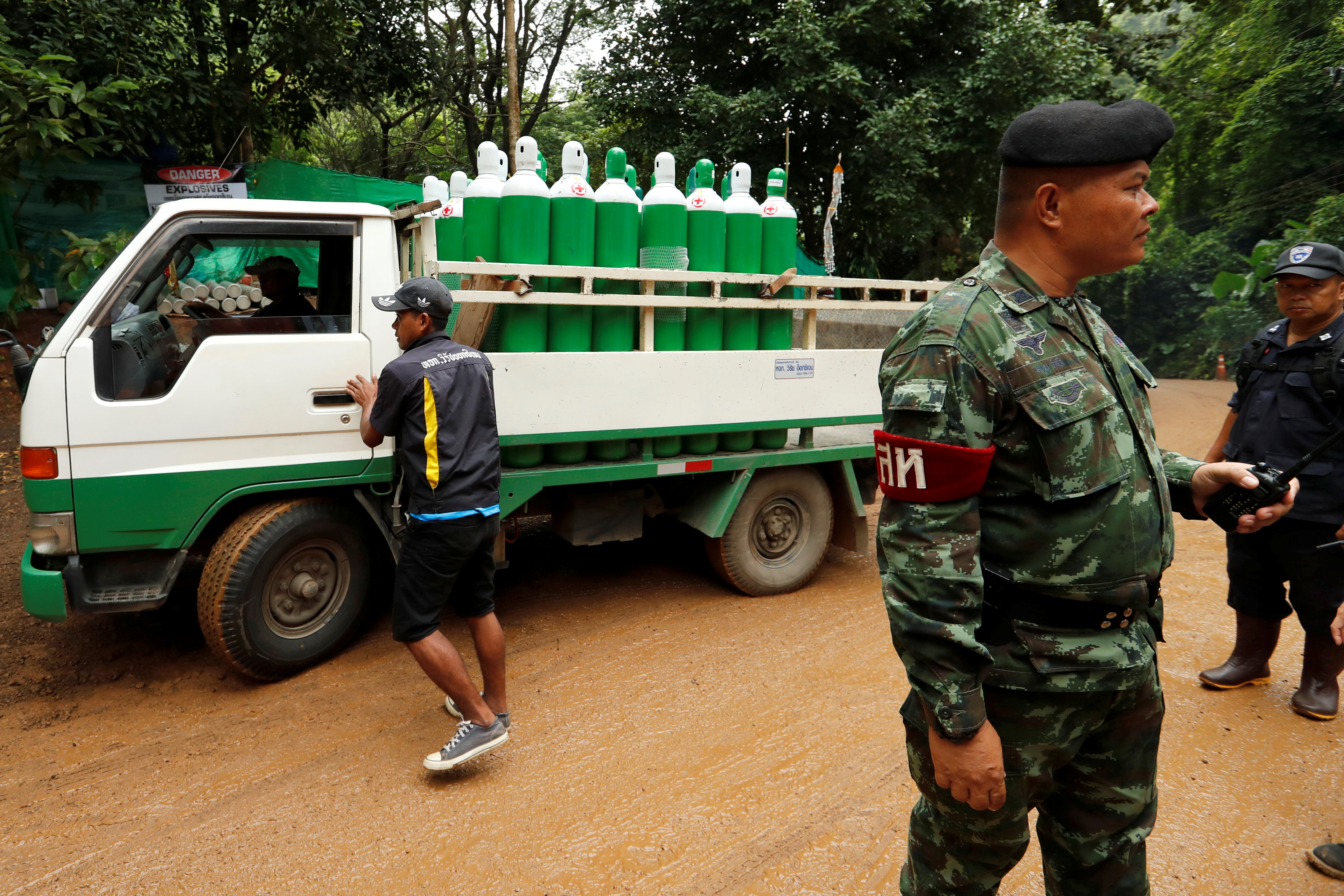 A truck carrying oxygen tanks arrives outside the Tham Luang cave complex, where 12 schoolboys and their soccer coach are trapped inside a flooded cave, in the northern province of Chiang Rai, Thailand, July 8, 2018.