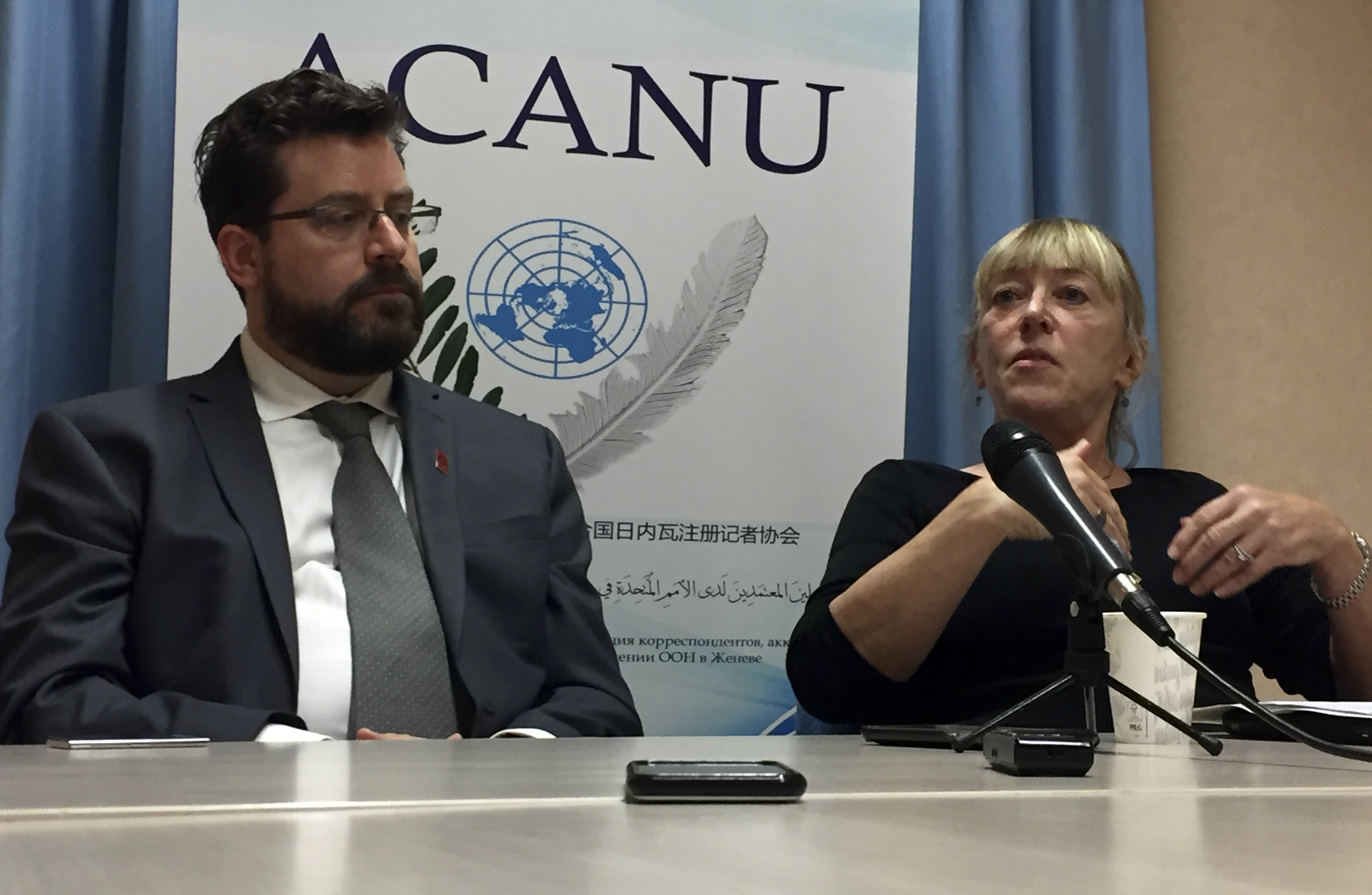 Peter Asaro, left, of the International Committee for Robot Arms Control, and Jody Williams of the Nobel Women's Initiative speak to reporters at a news conference in Geneva, Switzerland, Aug. 27, 2018.