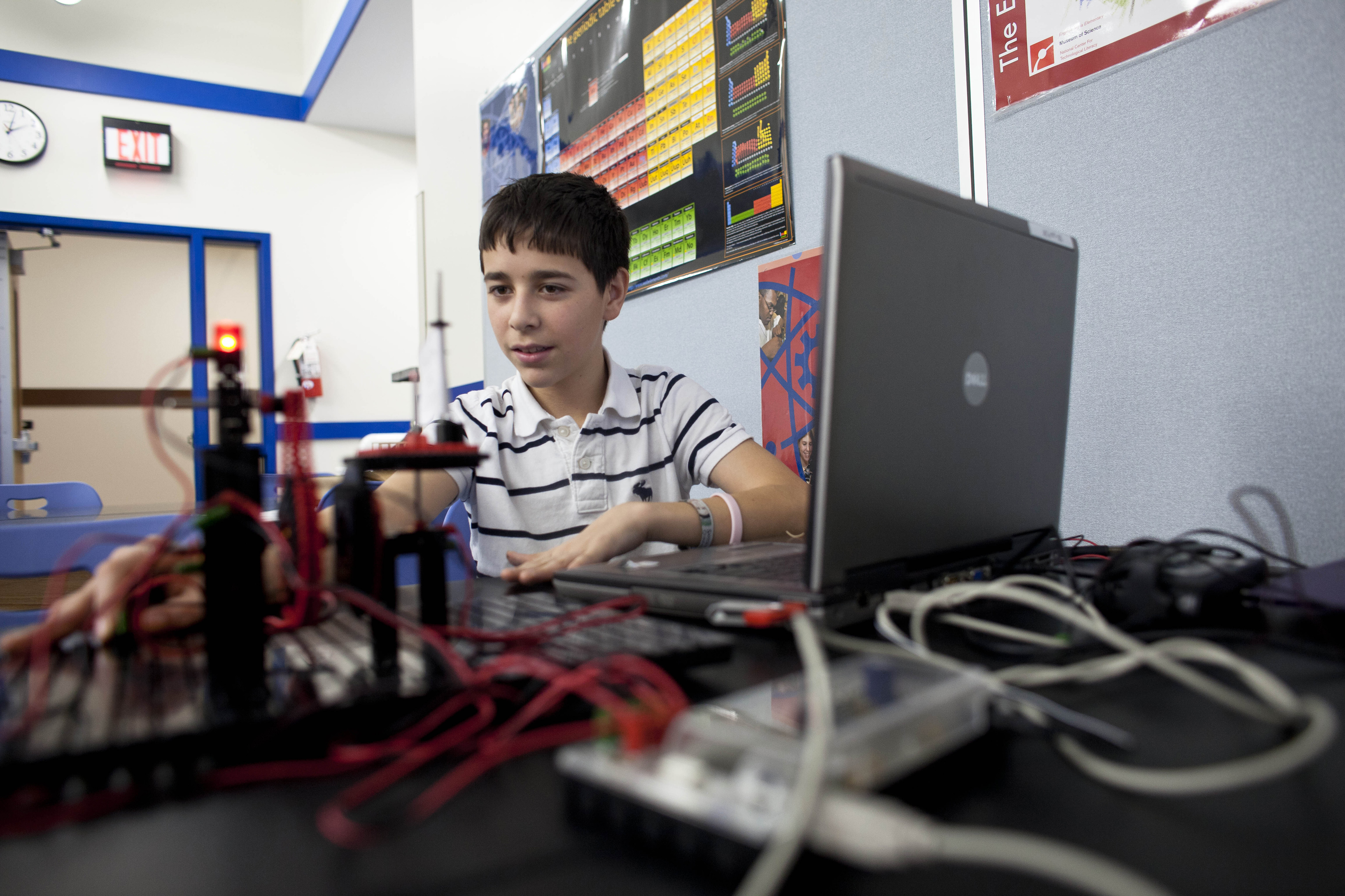 FILE - A student works on his robot at Escuela Vieau Middle School in Milwaukee, Wisconsin.