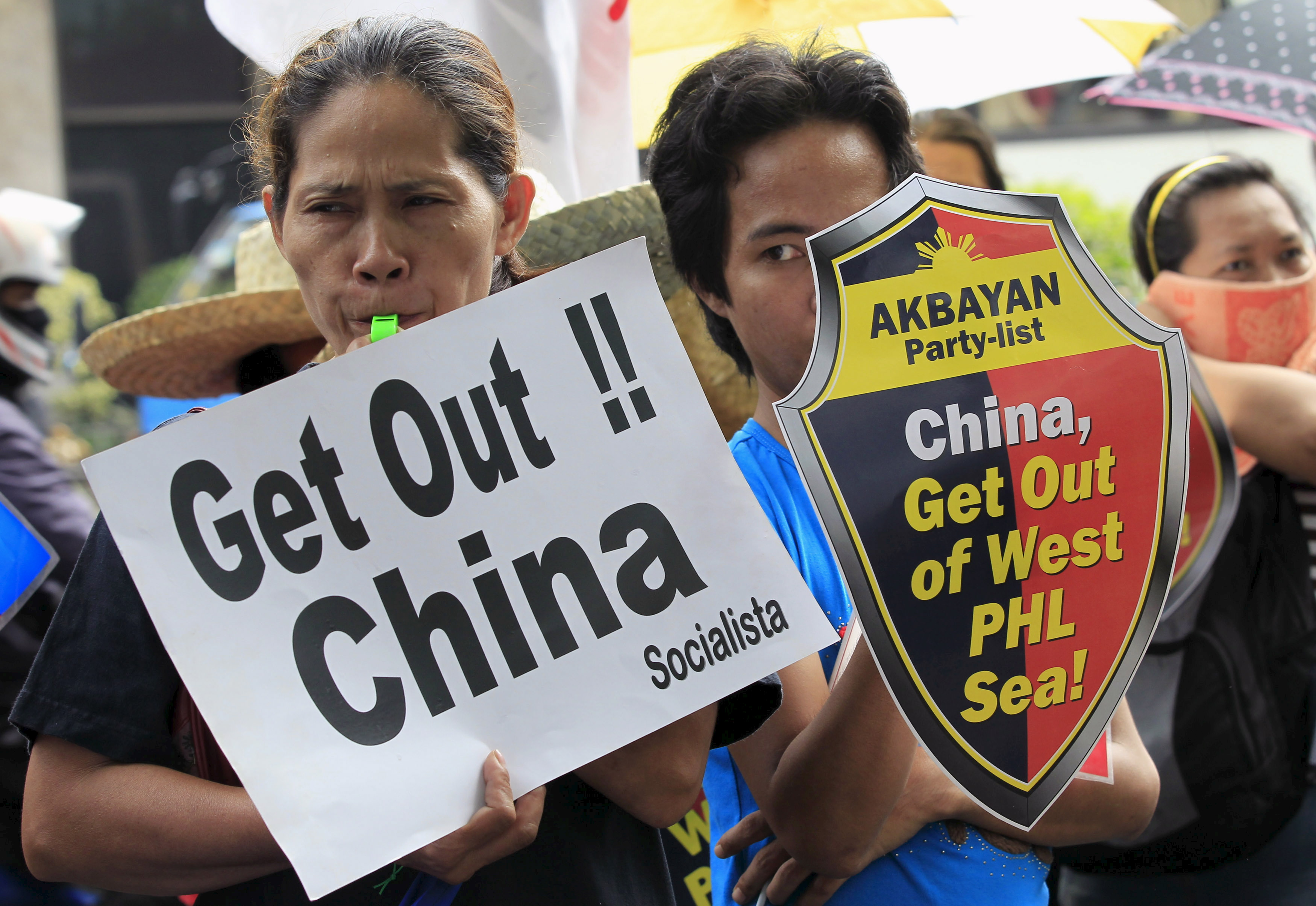 Protesters make noise during a rally regarding the disputed islands in the South China Sea, in front of the Chinese Consulate in Makati city, metro Manila July 24, 2015.