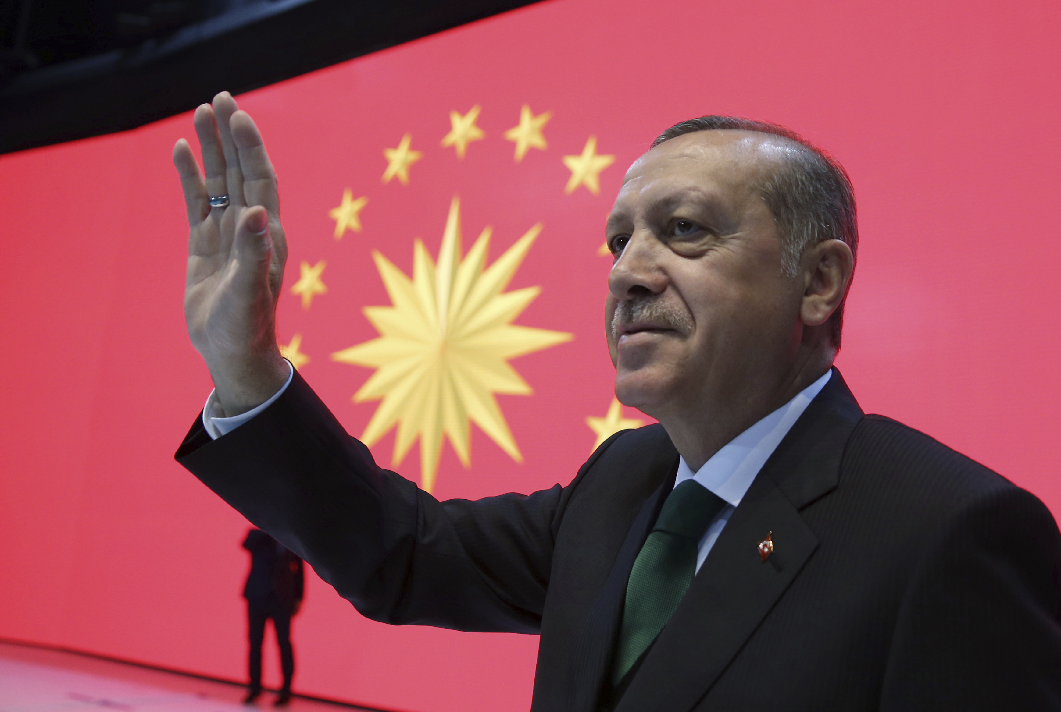 Turkey President Recep Tayyip Erdogan waves to his supporters during a meeting in Istanbul, March 27, 2017. Turkey hold a referendum on April 16 on whether to expand the powers of the Turkish presidency.