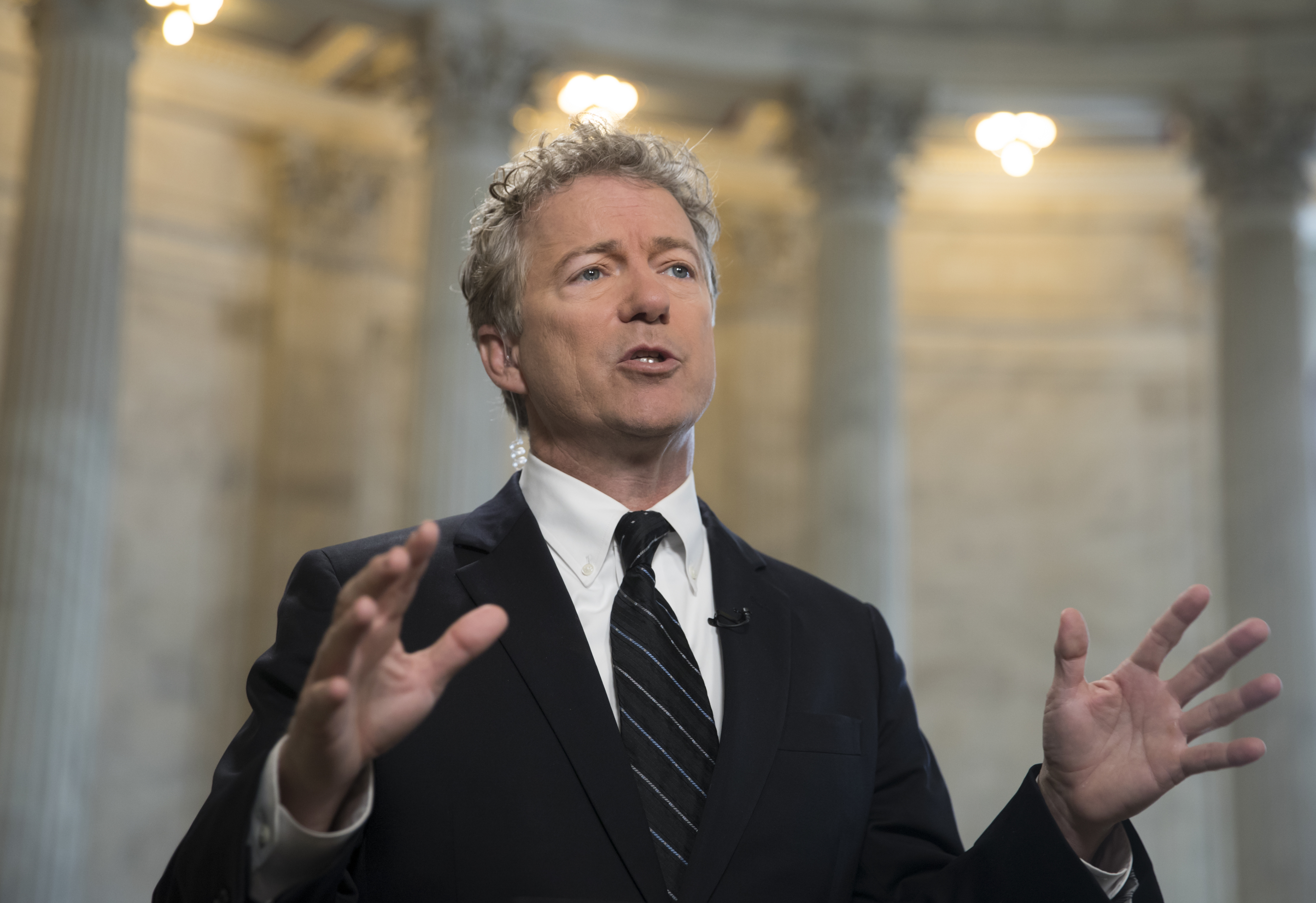FILE - Sen. Rand Paul, R-Ky., speaks during a TV news interview on Capitol Hill in Washington, March 21, 2018.