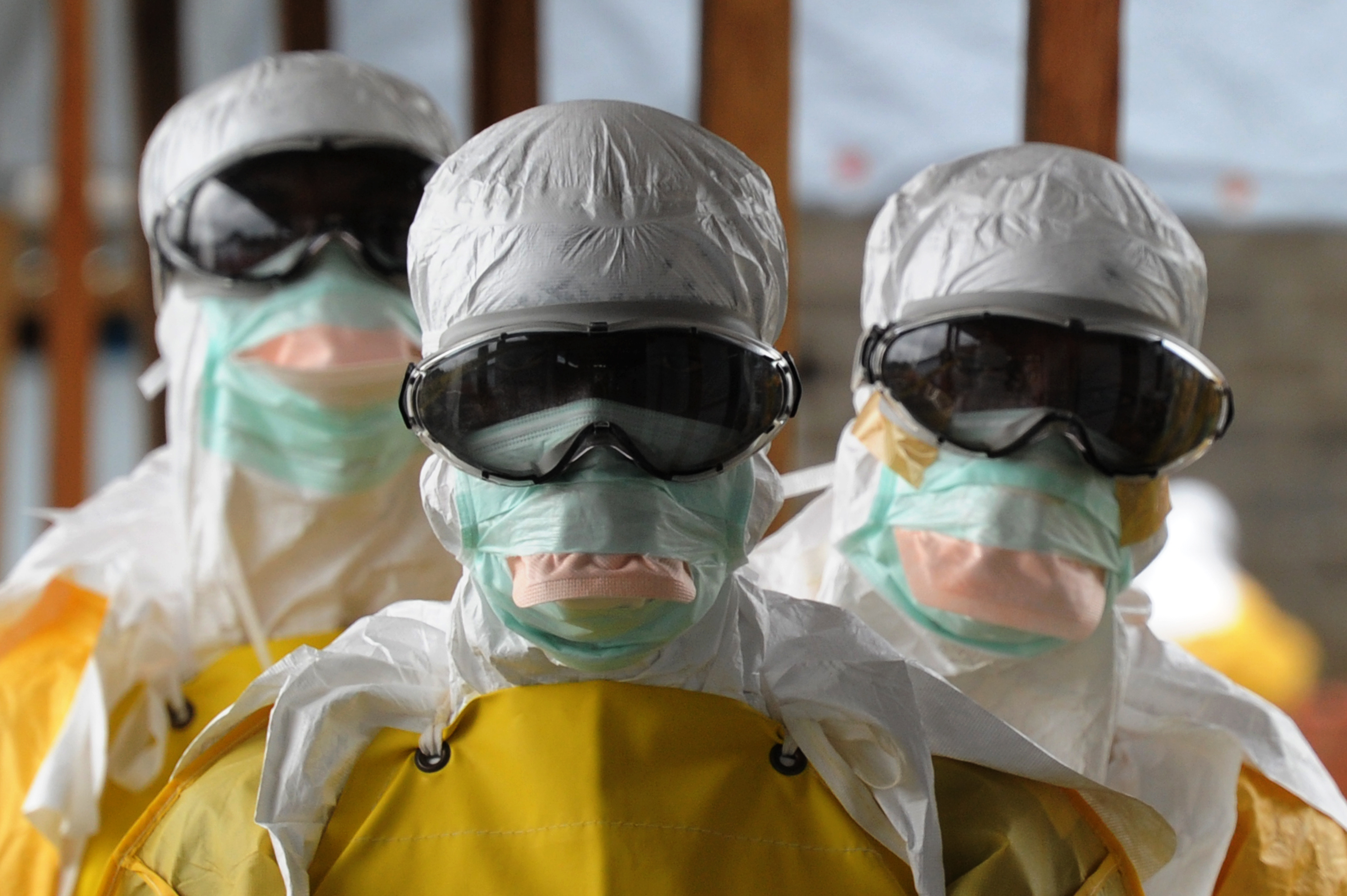 Health care workers, wearing protective suits, leave a high-risk area at the French NGO Medecins Sans Frontieres (Doctors without borders) Elwa hospital on Aug. 30, 2014 in Monrovia.