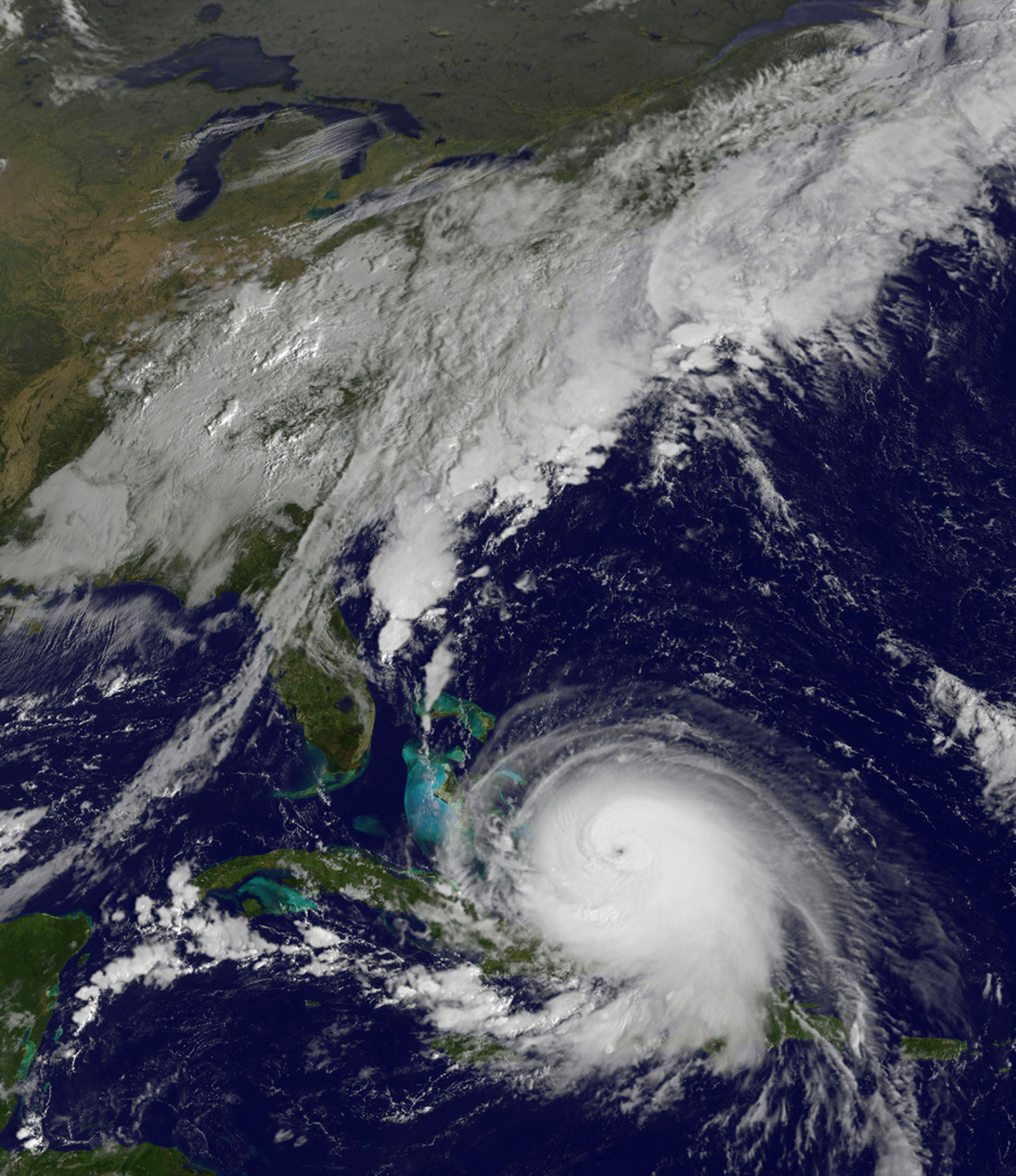 This satellite image taken Oct. 1, 2015, at 9:37 a.m. EDT, and released by the National Oceanic and Atmospheric Administration (NOAA), shows Hurricane Joaquin. The powerful Category 4 hurricane pounded lightly populated islands of the eastern Bahamas...