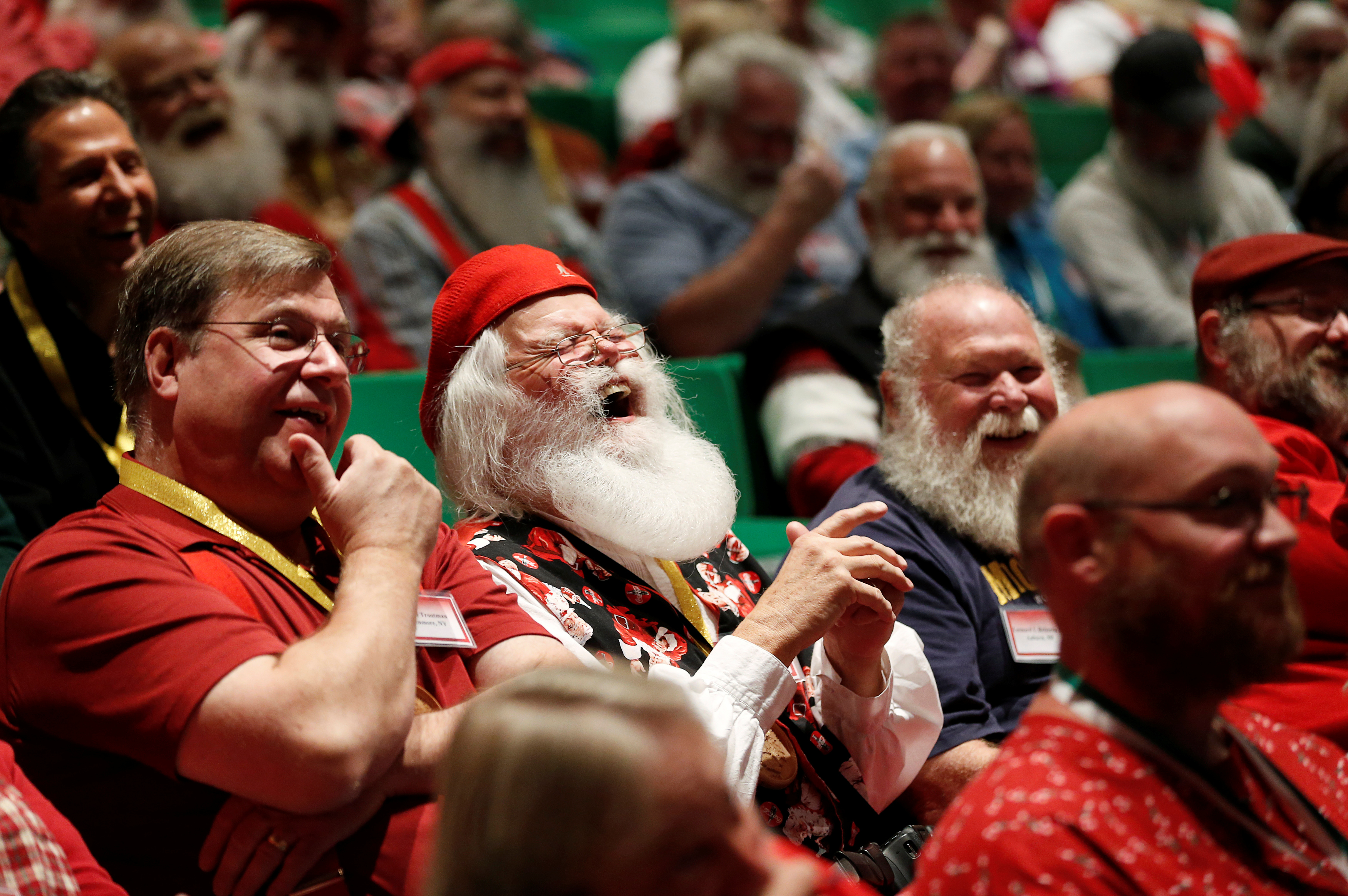 Santas laugh as they learn about Santa Spirit during class at the Charles W. Howard Santa Claus School in Midland, Michigan, Oct. 27, 2016.