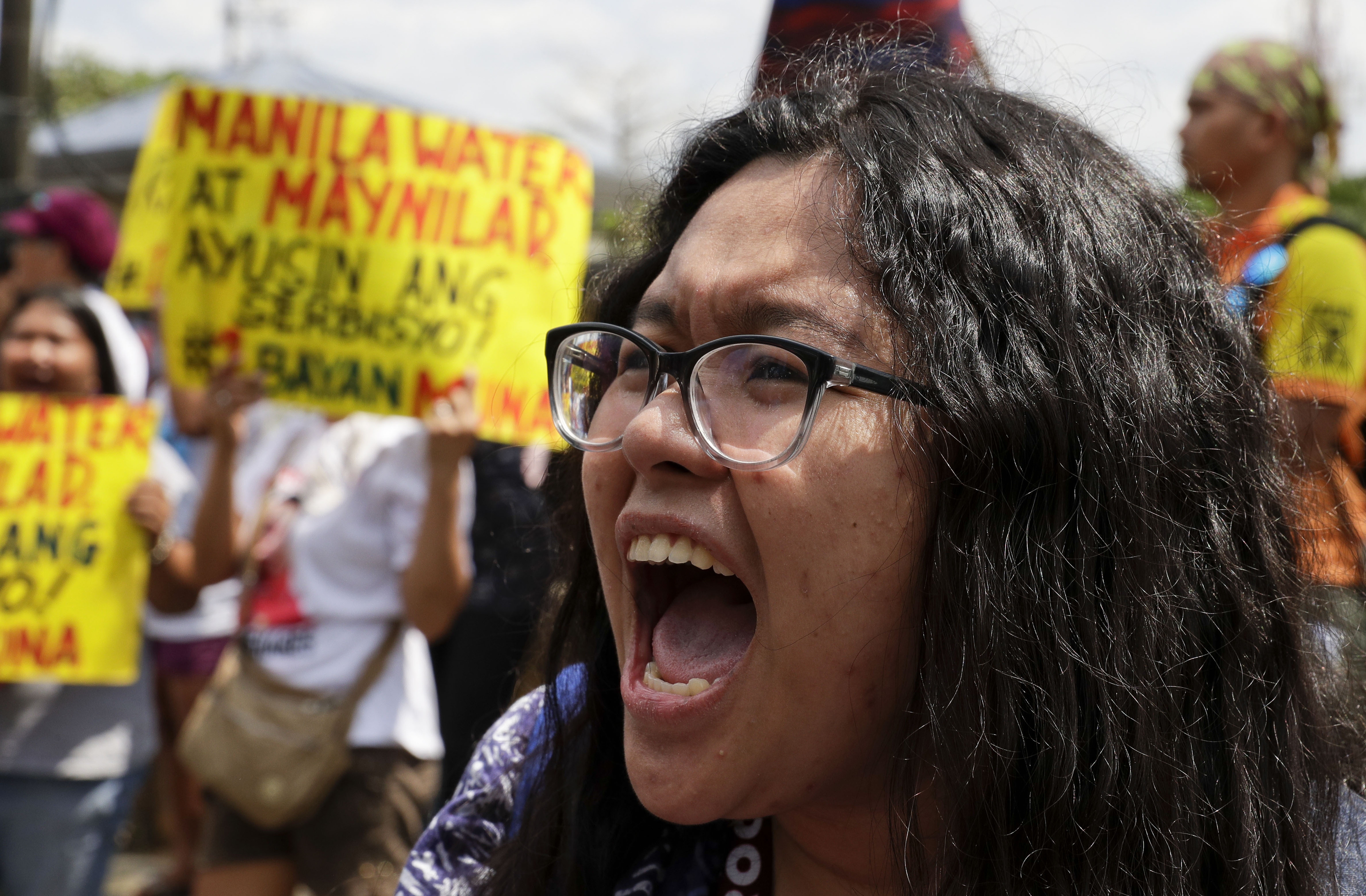 A protester shouts during a rally outside the offices of the Metropolitan Waterworks and Sewerage System and Manila Water Company in Quezon city, metropolitan Manila, Philippines to demand better water supply, March 15, 2019.