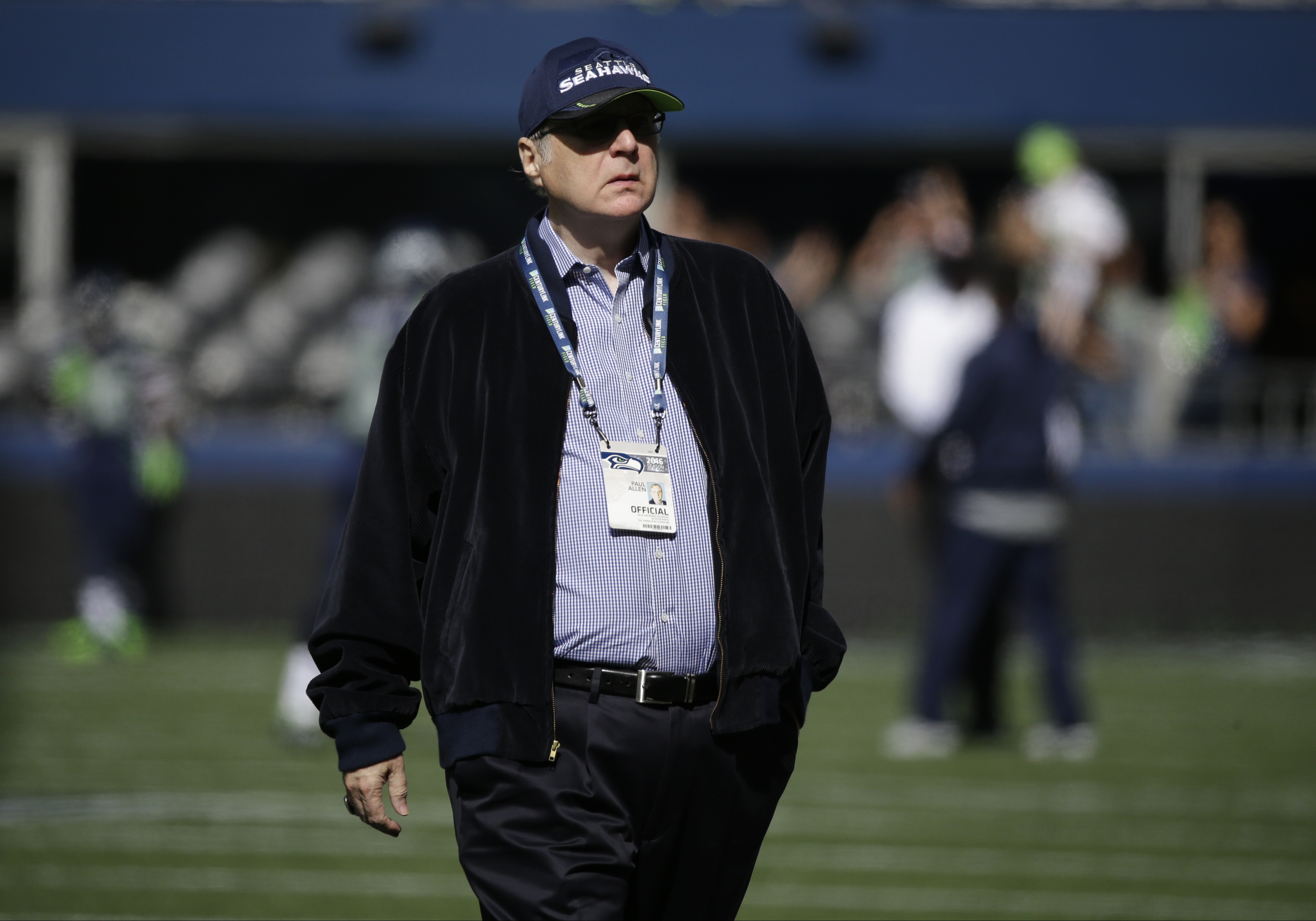 Seattle Seahawks team owner Paul Allen walks on the field before an NFL football game against the San Francisco 49ers, Sept. 25, 2016, in Seattle.