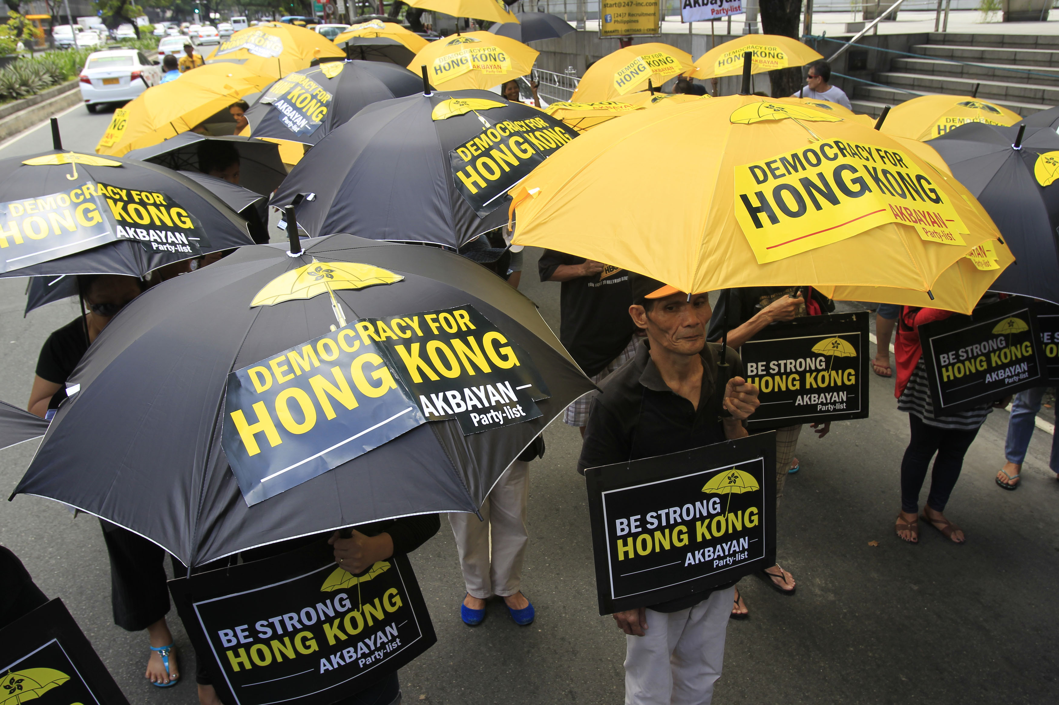 Activists in support of the pro-democracy demonstrations in Hong Kong protest in front of the Chinese Consular office in Makati city, metro Manila, Oct. 2, 2014.