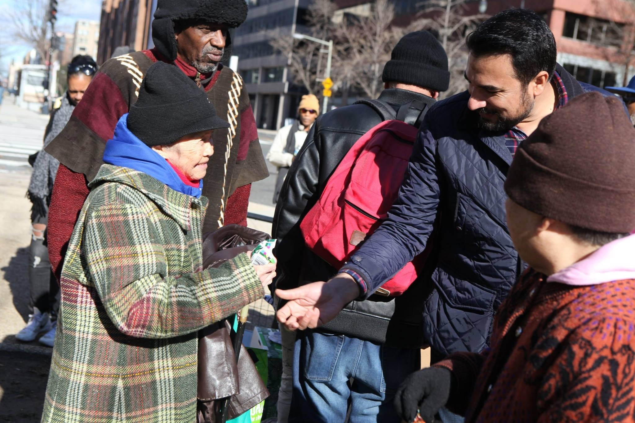 Kazi Mannan distributes food to the needy at a local food and coat drive -- one of many he organizes every year. (K.Mannan)