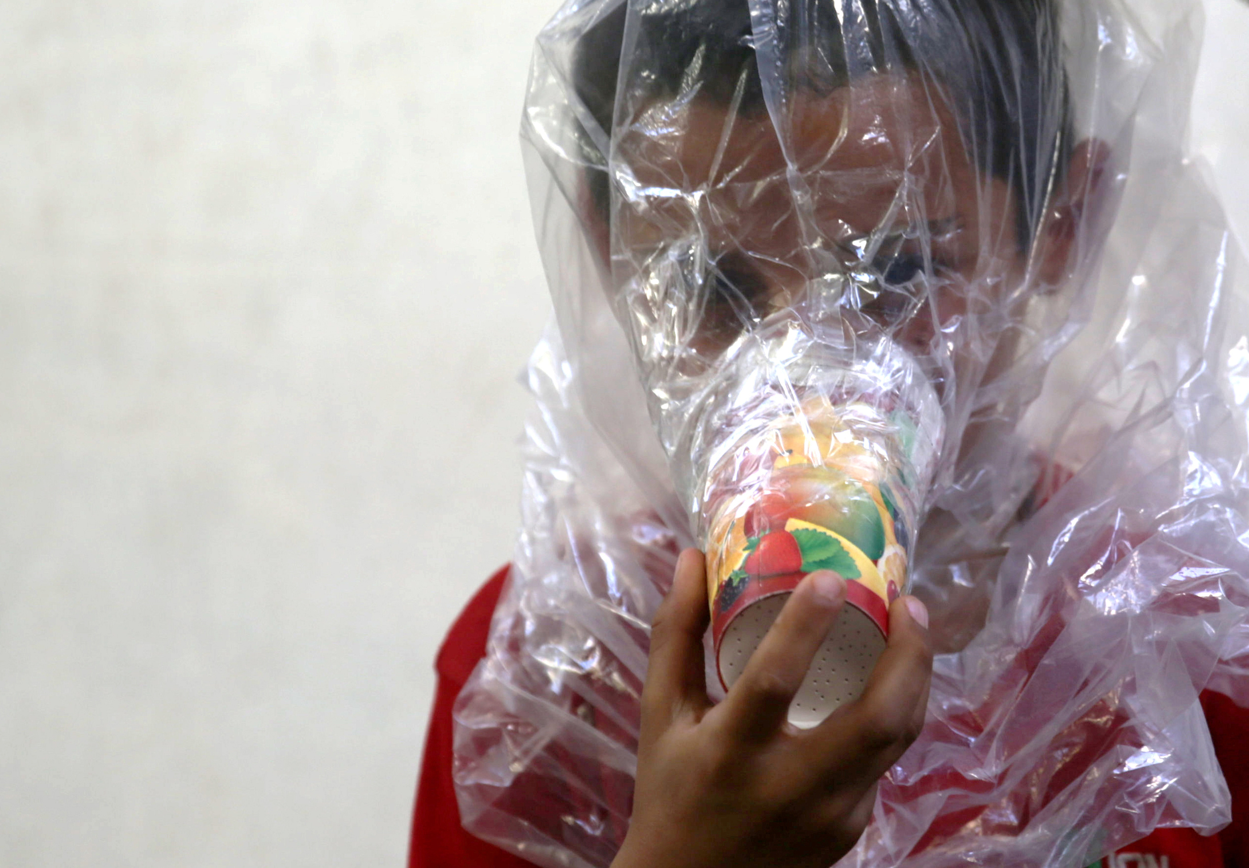 A boy tries on an improvised gas mask in Idlib, Syria, Sept. 3, 2018. The U.S. special adviser for Syria, Jim Jeffrey, said there is evidence that chemical weapons are being prepared by Syrian forces around Idlib.