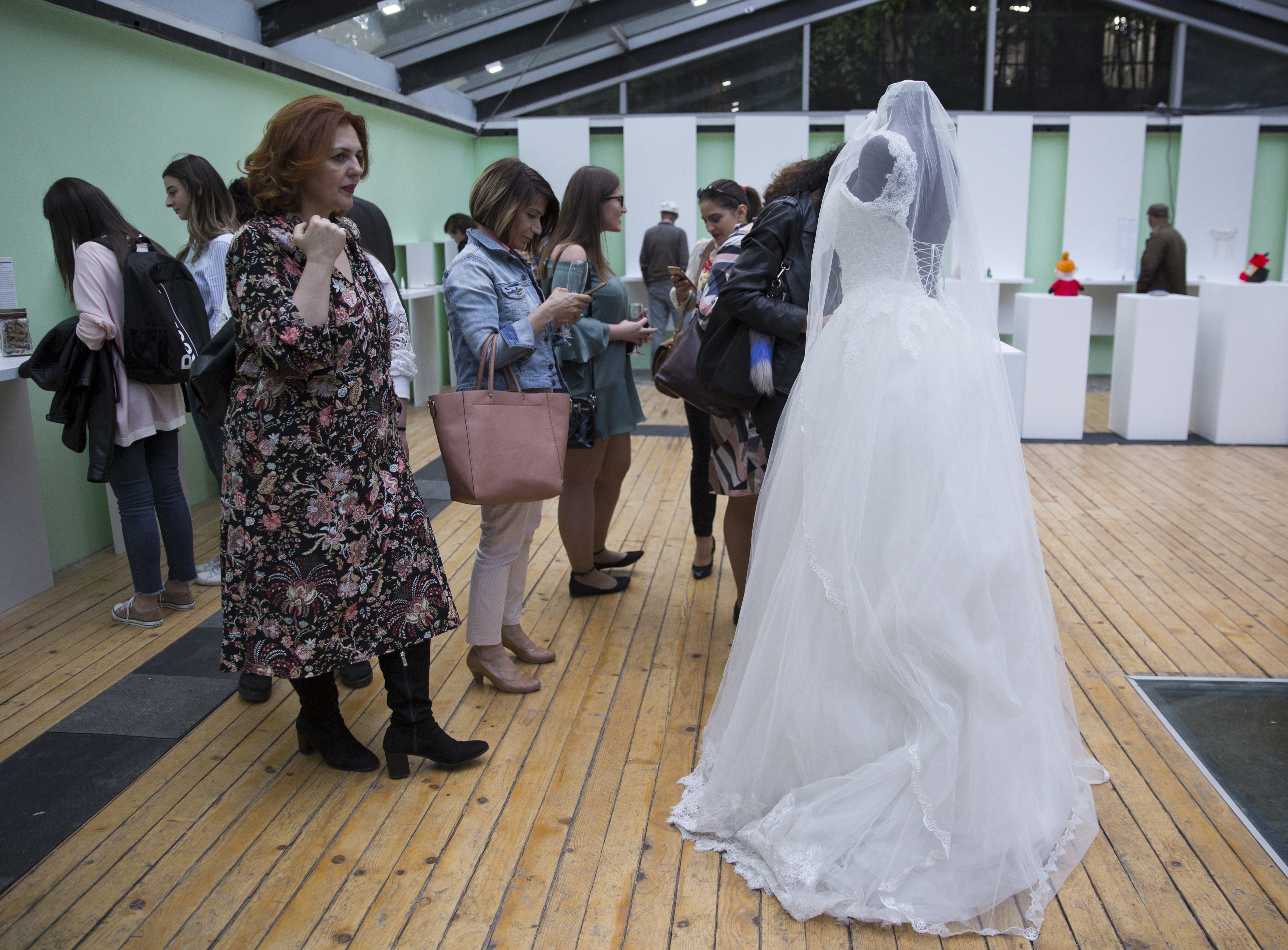A visitor looks at a wedding dress displayed at the Museum of Broken Relationships in Pristina, Kosovo,May 3, 2018. The dress belongs to a Turkish woman who lost her husband-to-be the day they would get married, June 28, 2016, when a terrorist attack...