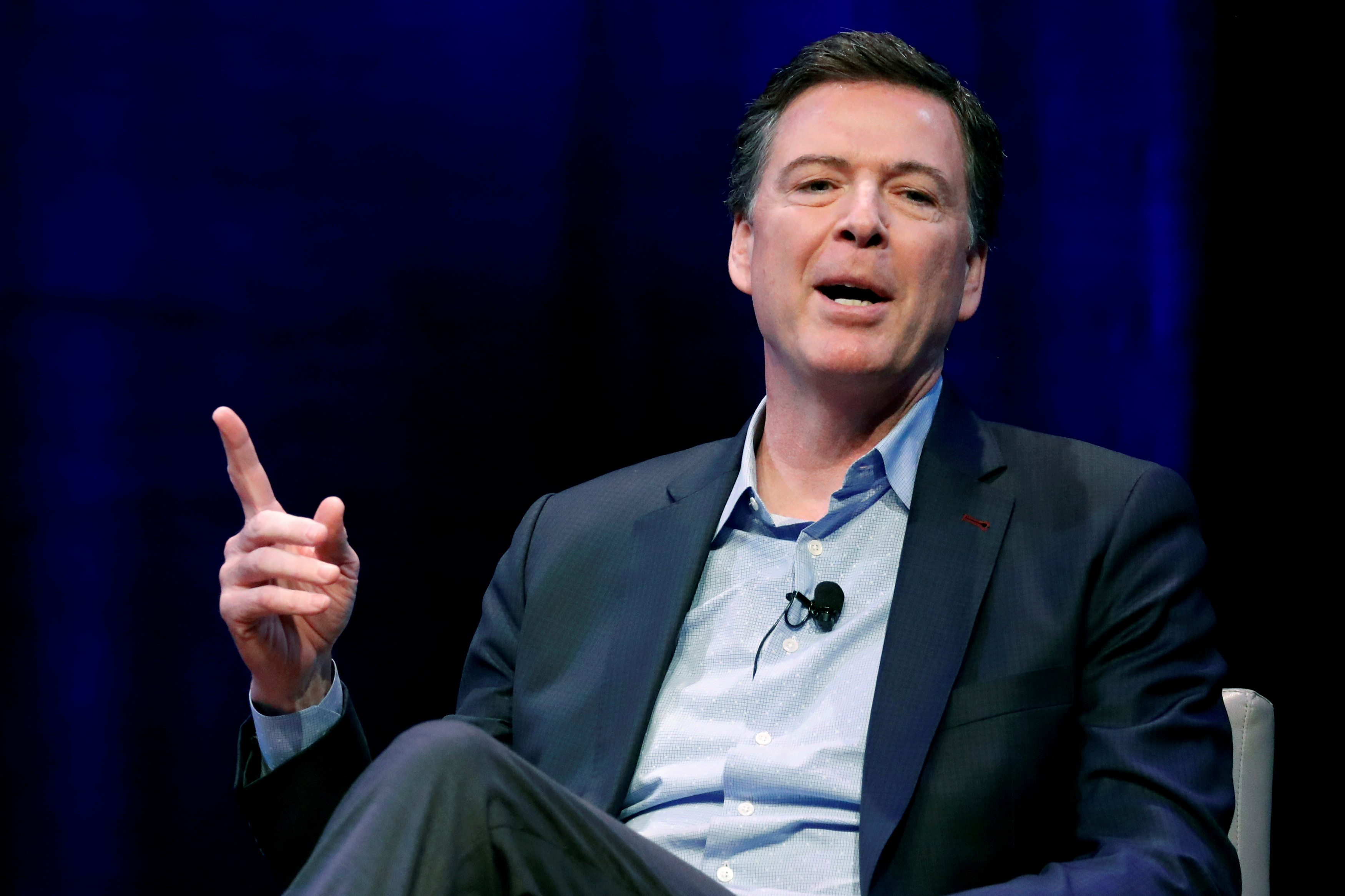 FILE - Former FBI director James Comey speaks during an interview with Axios Executive Editor Mike Allen at George Washington University in Washington, April 30, 2018.