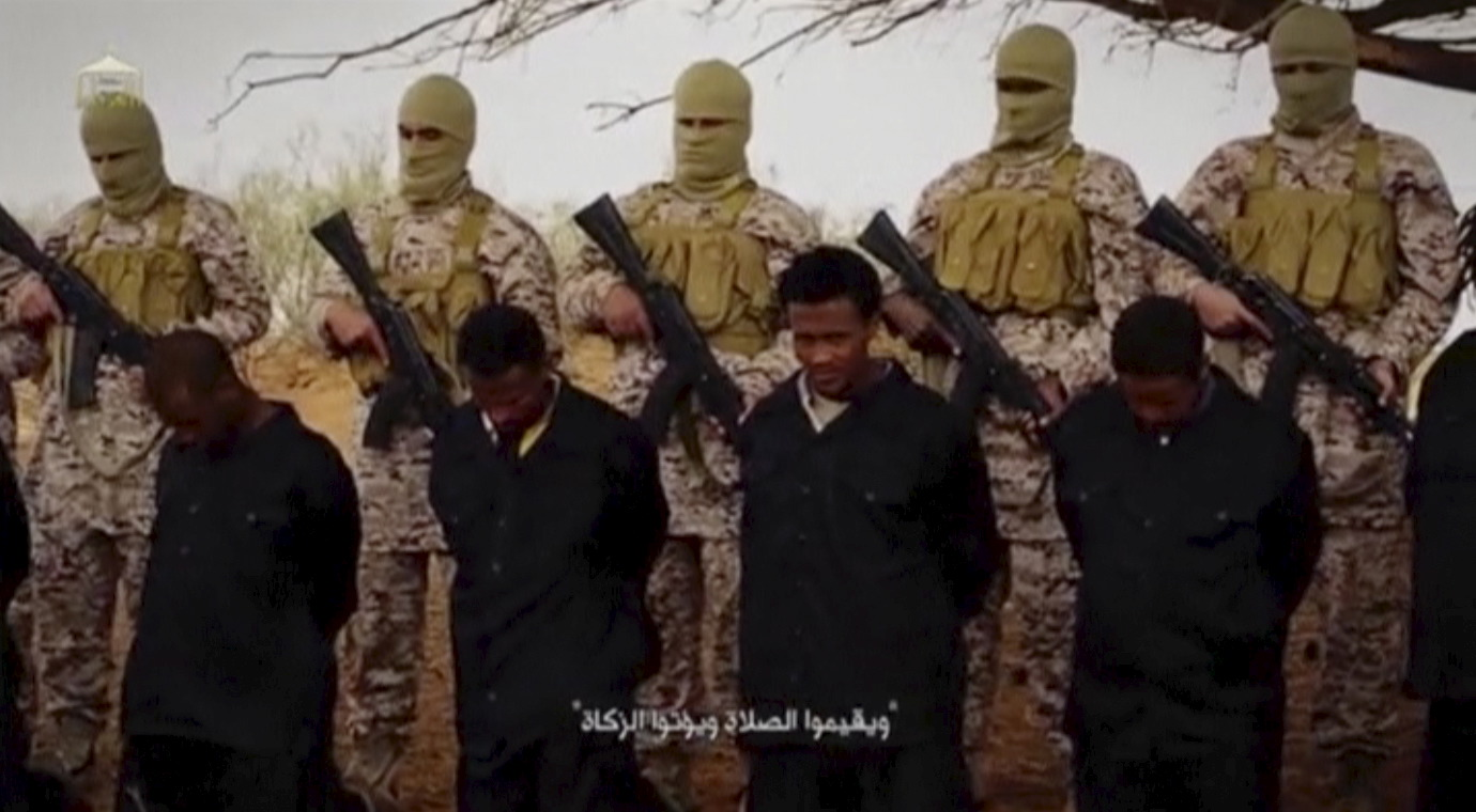Militants from the so-called Islamic State stand behind what are said to be Ethiopian Christians in Libya, in this still image from an undated video posted to a social media website on April 19, 2015. The video appeared to show militants shooting and...