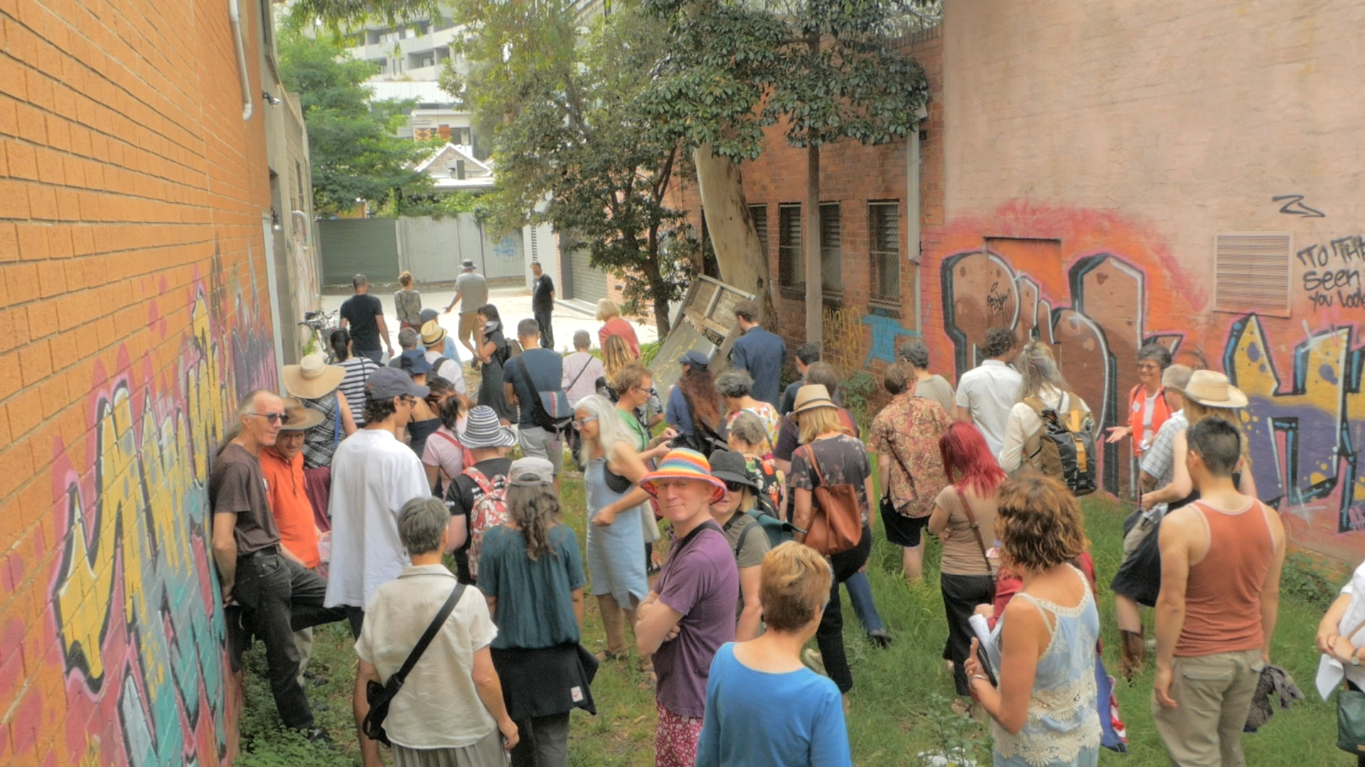 Members of Urban Coup tour the site of their planned co-housing project in Melbourne, Australia.