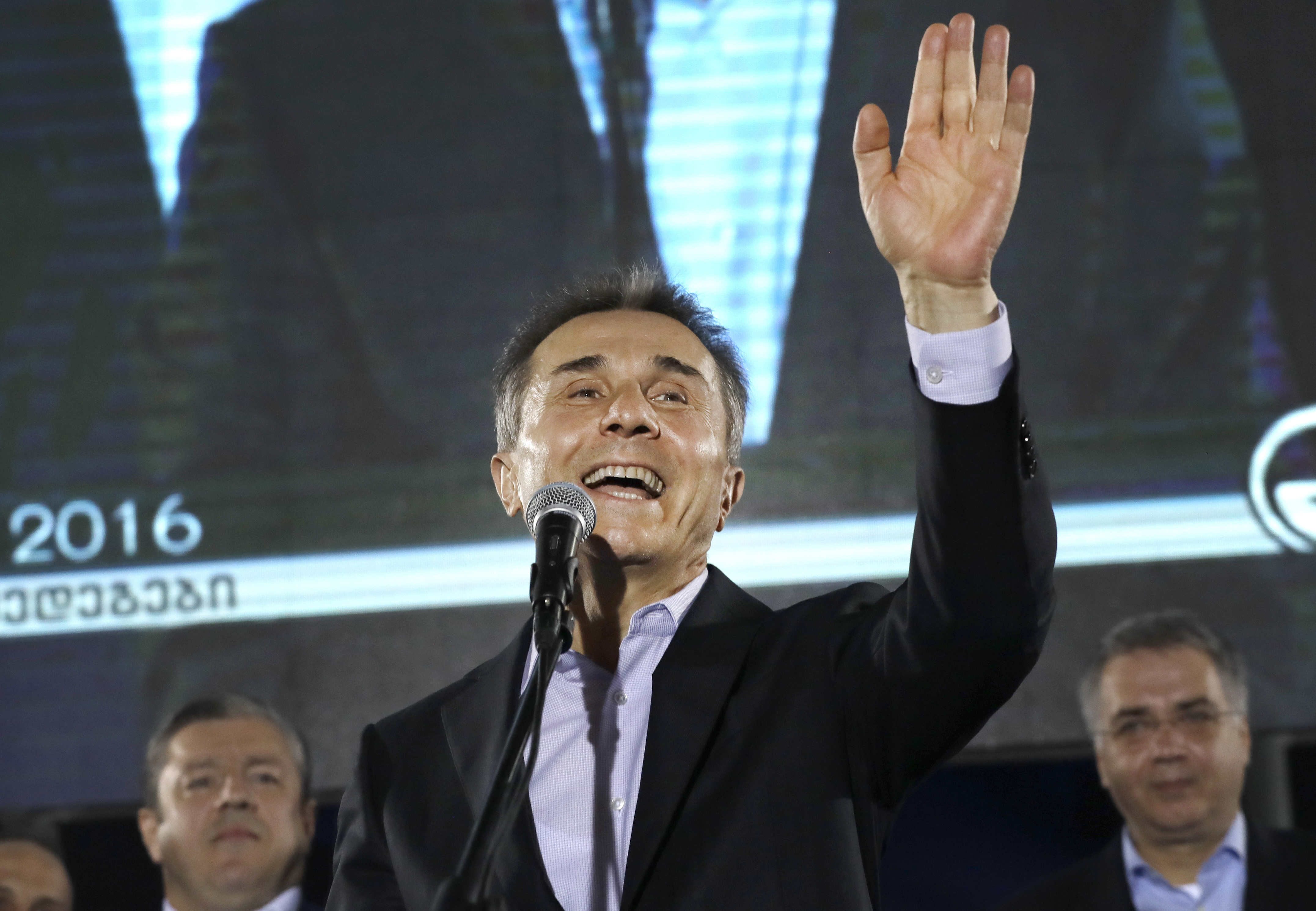 FILE - In this Oct. 8, 2016, photo, Georgian businessman Bidzina Ivanishvili greets supporters during a rally in Tbilisi, Georgia.