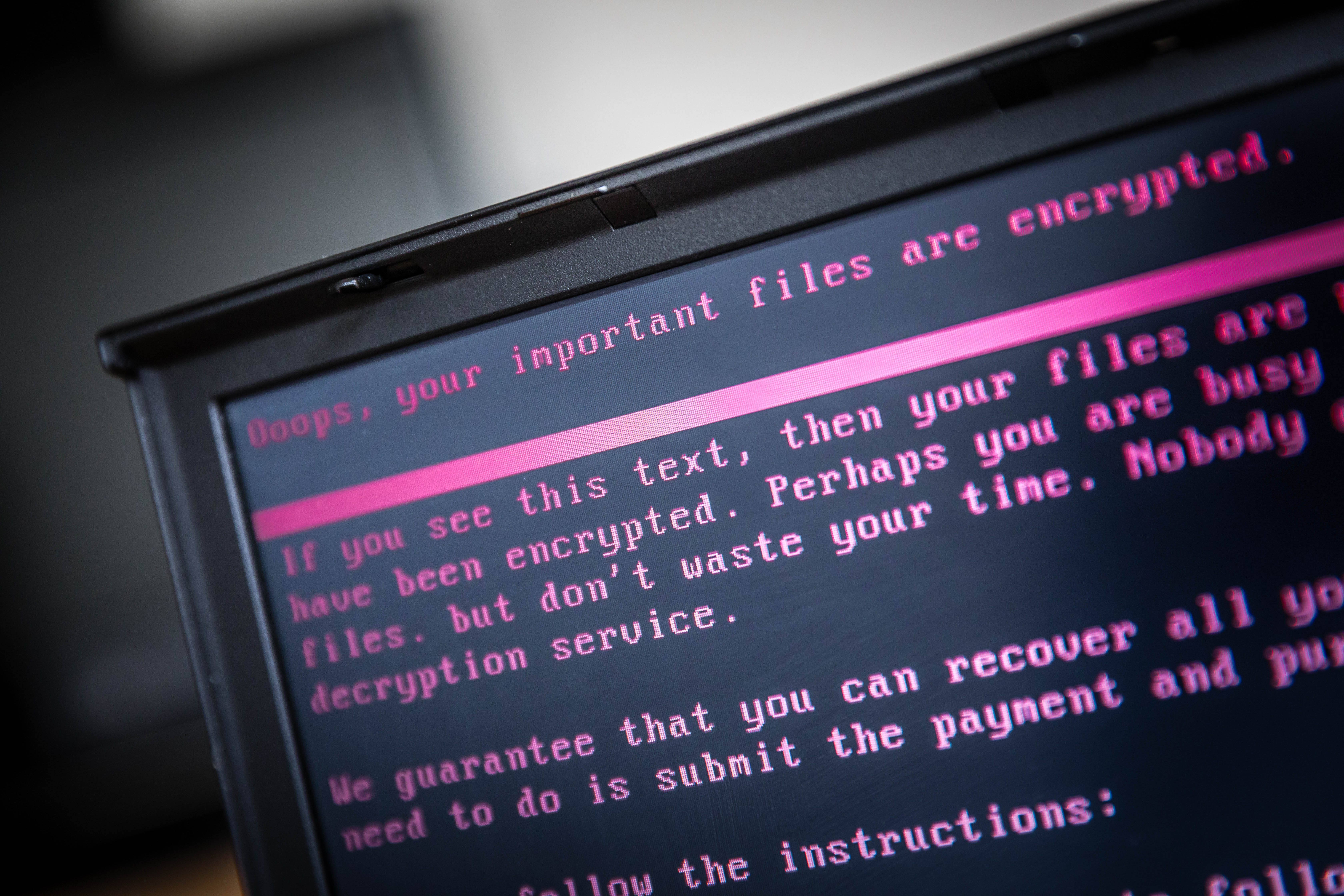 A laptop displays a message after being infected by ransomware as part of a worldwide cyberattack on June 27, 2017 in Geldrop, Netherlands.