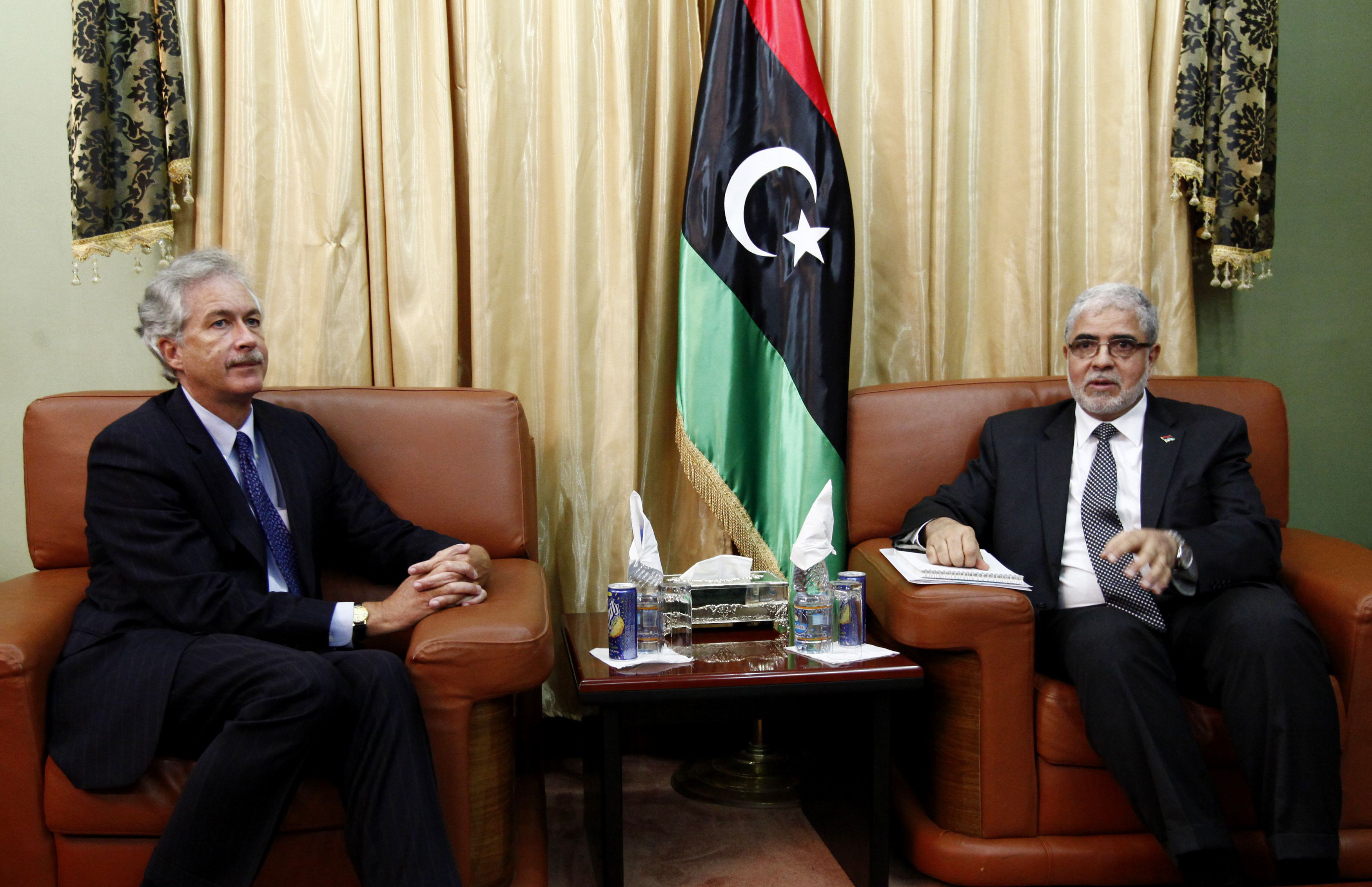 Libya's Prime Minister Mustafa Abu Shagour (R) meets visiting U.S. Deputy Secretary of State William Burns in Tripoli, Libya, September 20, 2012.