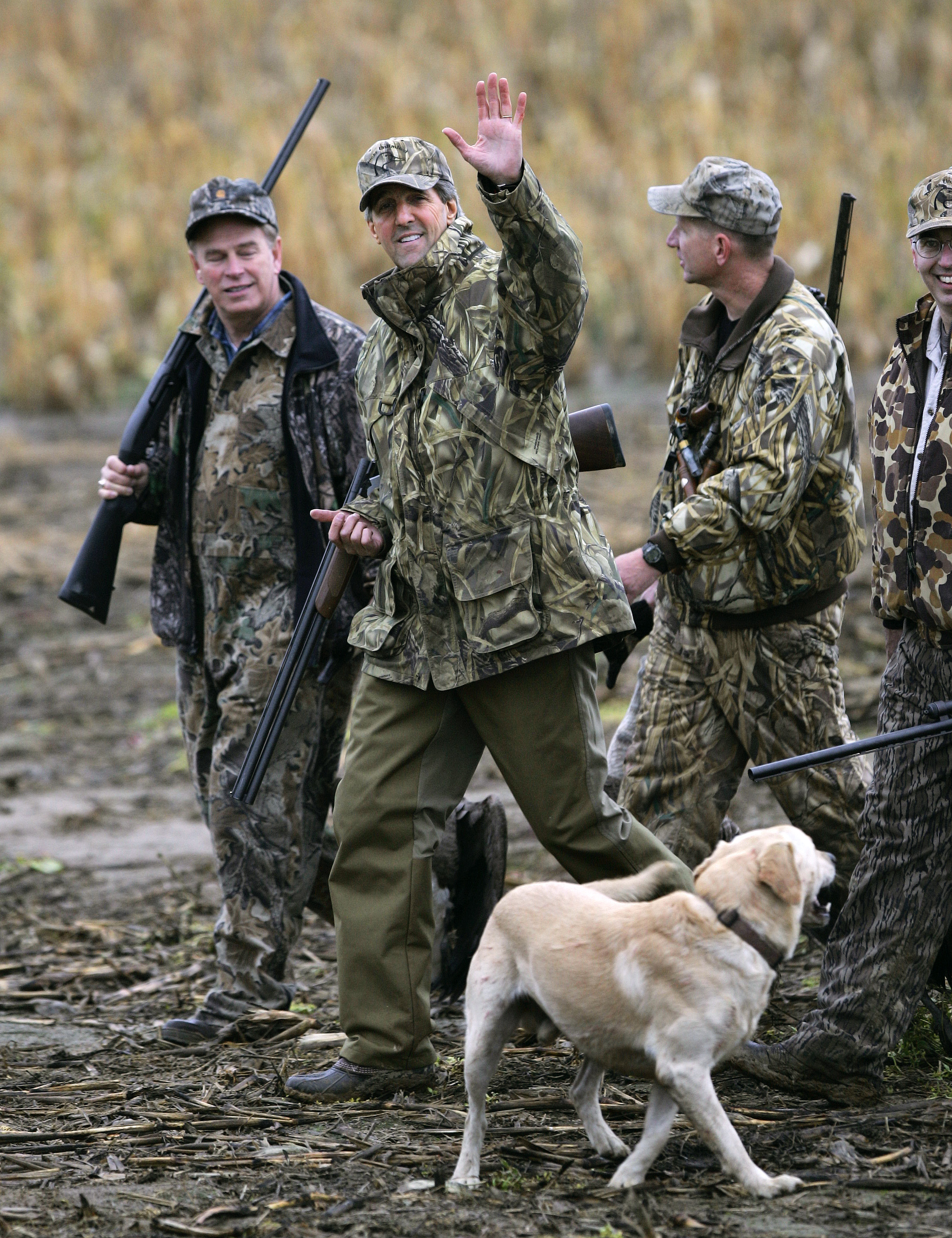 FILE - Democratic Presidential candidate Senator John Kerry, D-Mass., second from left, waves as he returns from a goose hunting trip in Poland, Ohio, Oct. 21, 2004.
