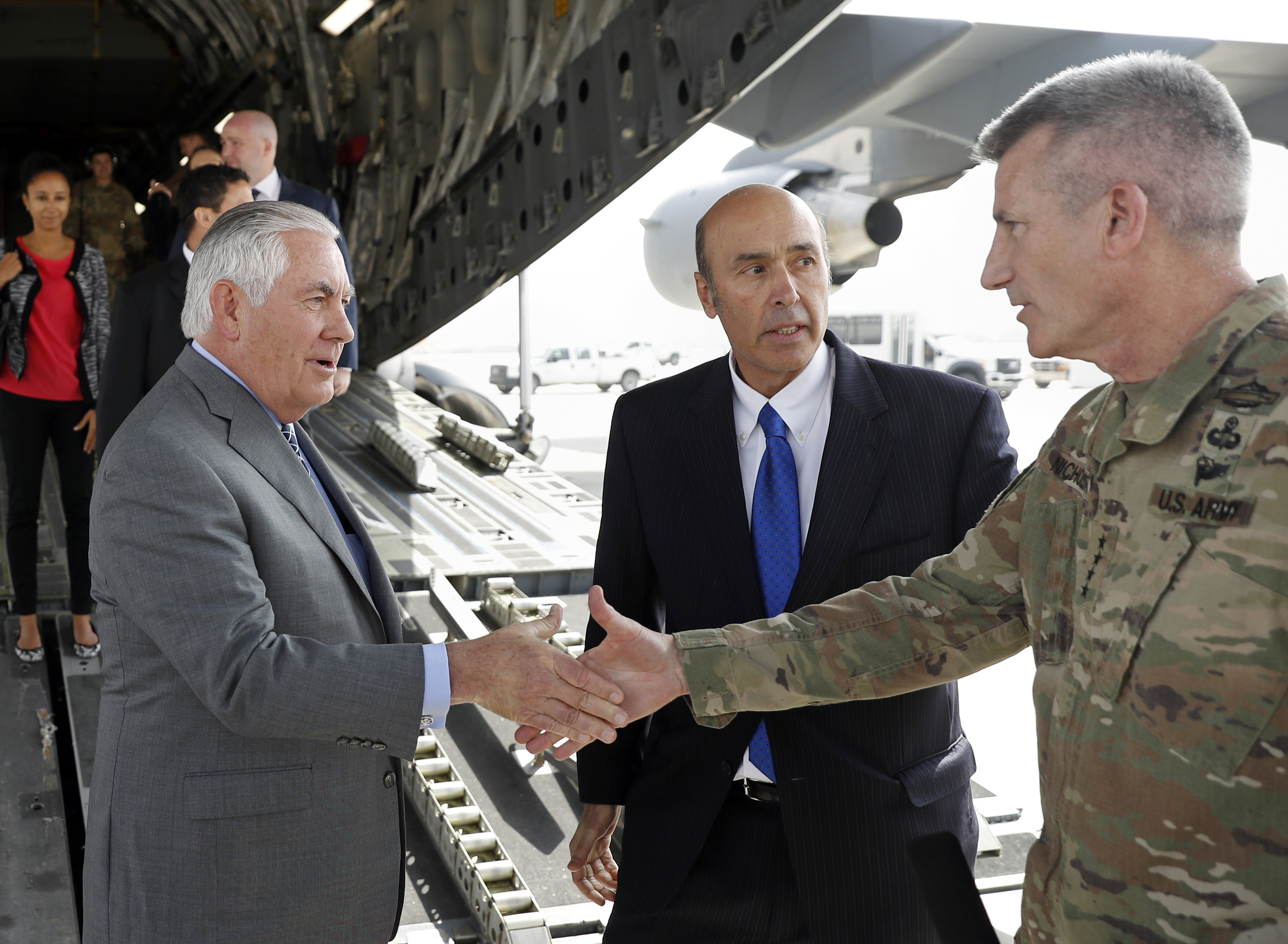 Secretary of State Rex Tillerson is greeted by Gen. John Nicholson, right, commander of Resolute Support, with Special Charge d'Affaires Amb. Hugo Llorens, as he arrives, Oct. 23, 2017, at Bagram Air Base, Afghanistan.