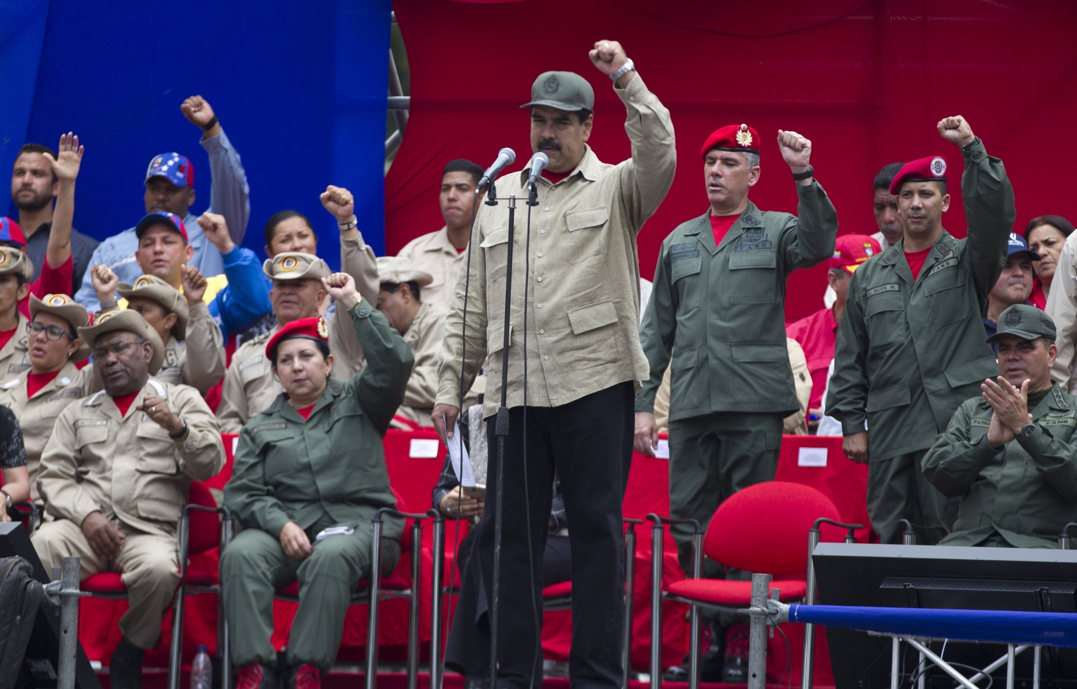 FILE - In this April 17, 2017, photo, Venezuela's President Nicolas Maduro leads the seventh anniversary celebration of the Bolivarian Militia, in front of the Miraflores presidential palace in Caracas, Venezuela.