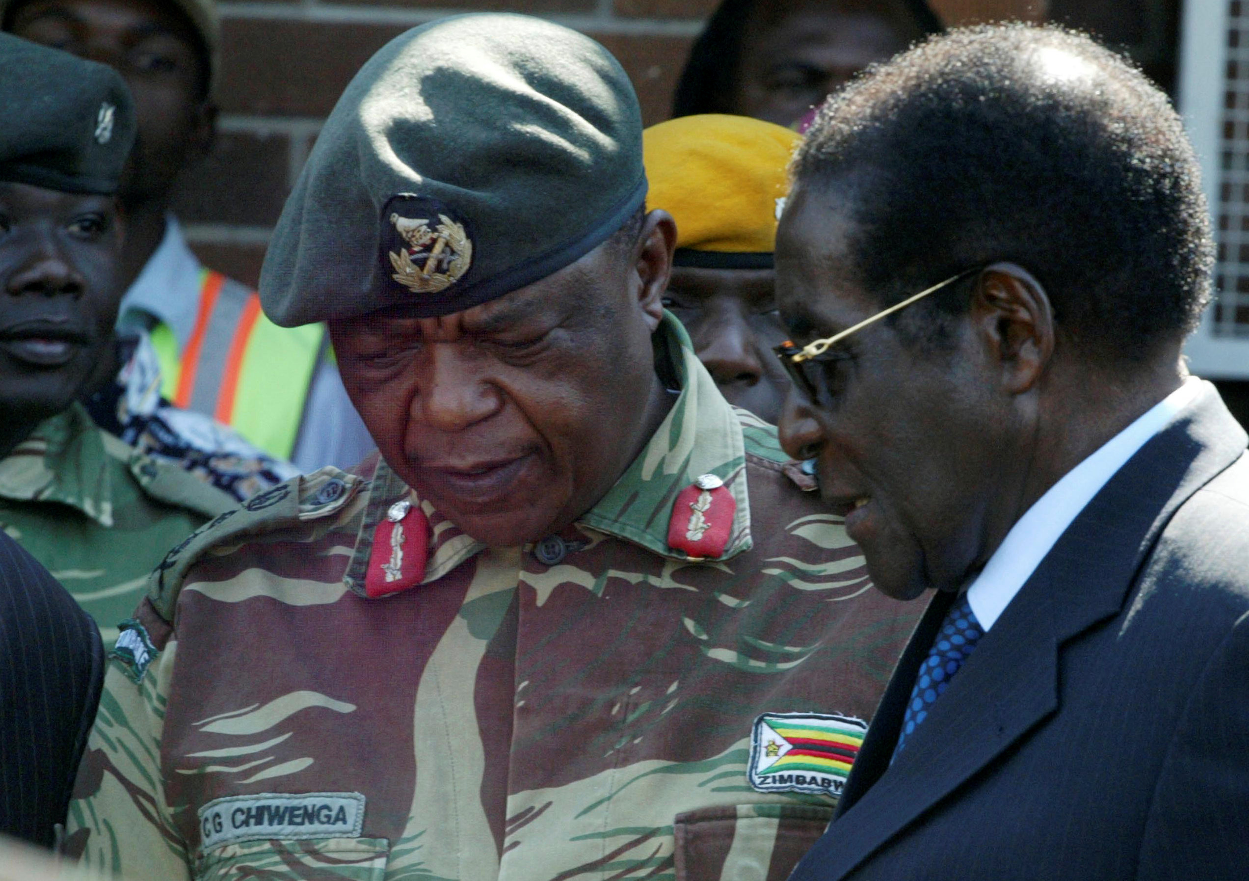FILE - President Robert Mugabe talks to General Constantino Chiwenga in Harare, Zimbabwe.