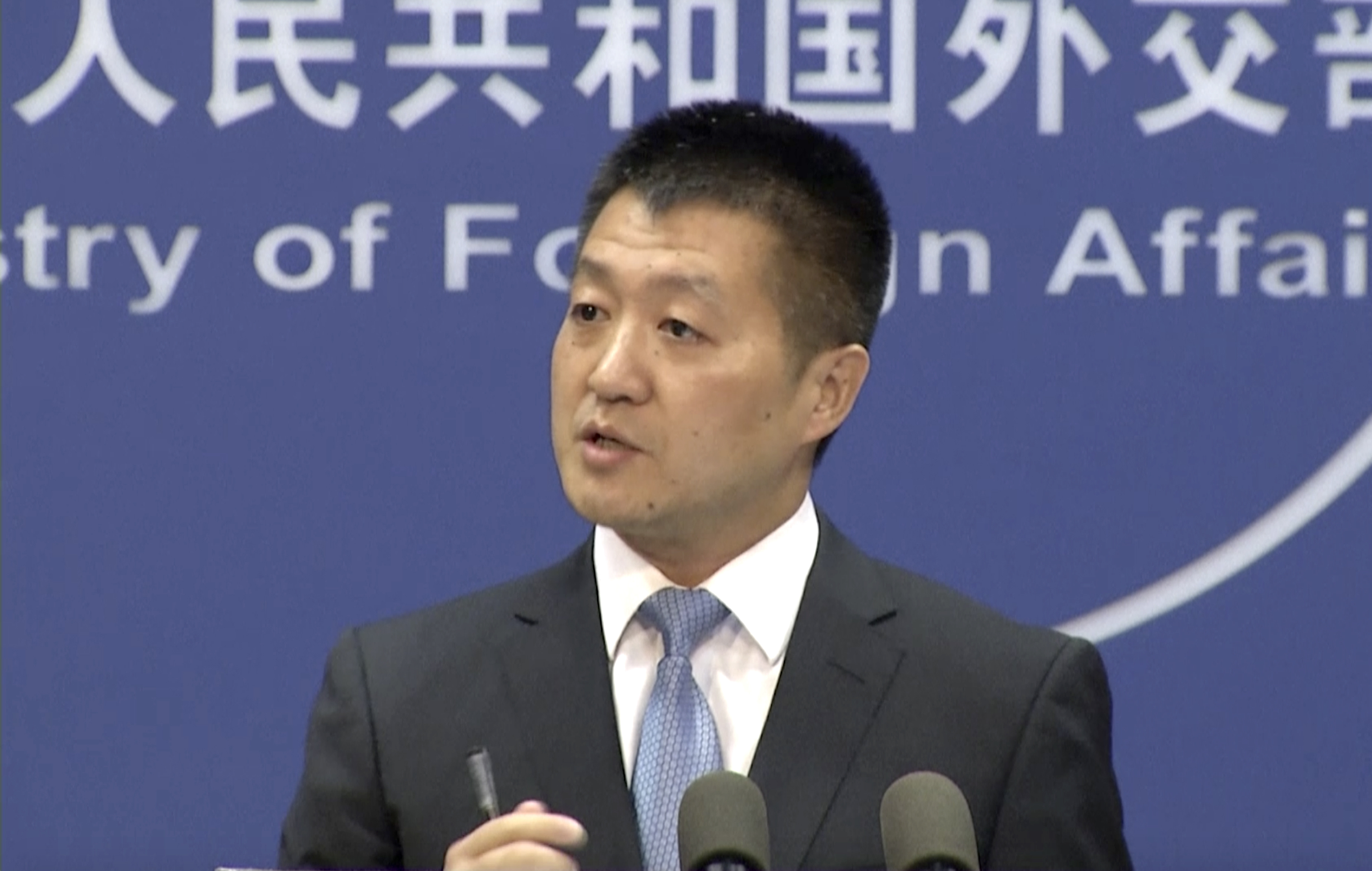 Lu Kang, spokesman of the Chinese Ministry of Foreign Affairs, speaks to reporters about the international tribunal's ruling on the South China Sea during a news briefing in Beijing, July 12, 2016.