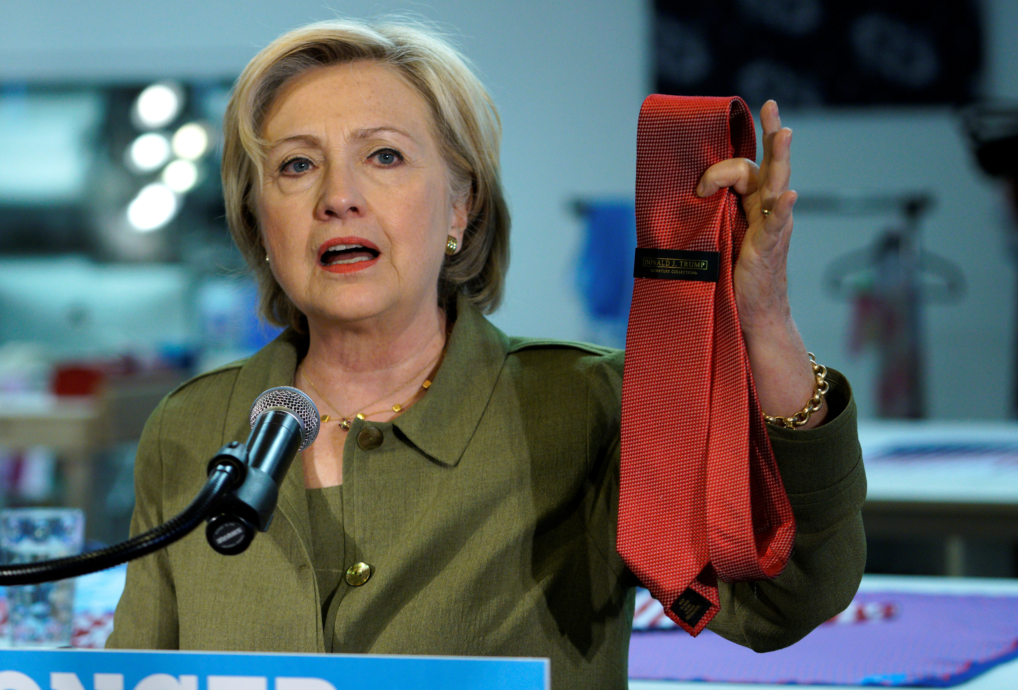 U.S. Democratic presidential nominee Hillary Clinton holds up a Donald Trump-brand tie made in China during a stop at a local tie company in Denver, Colorado, Aug. 3, 2016.