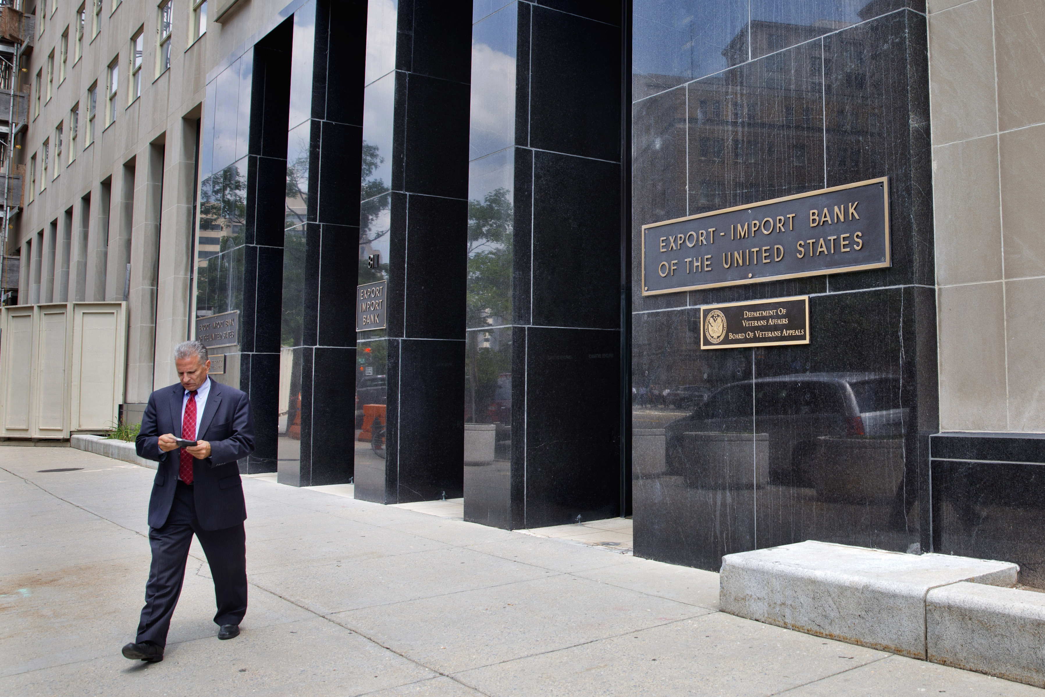 FILE - a man walks out of the Export-Import Bank of the U.S. in Washington. With little fanfare, Congress has revived the federal Export-Import Bank five months after allowing it to expire.