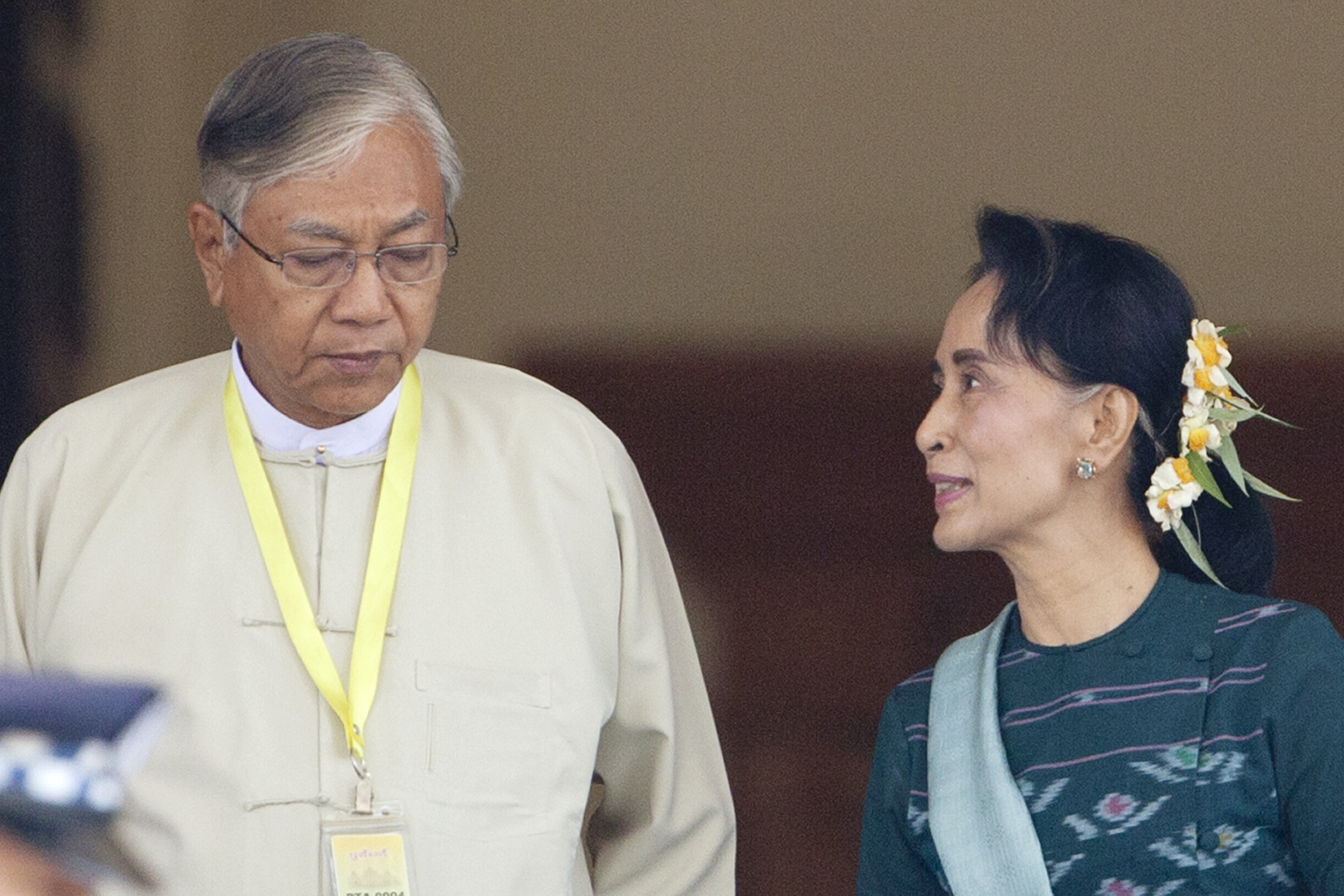 Htin Kyaw, left, newly elected president of Myanmar, walks with National League for Democracy leader Aung San Suu Kyi at Myanmar's parliament in Naypyitaw, Myanmar, Tuesday, March 15, 2016.