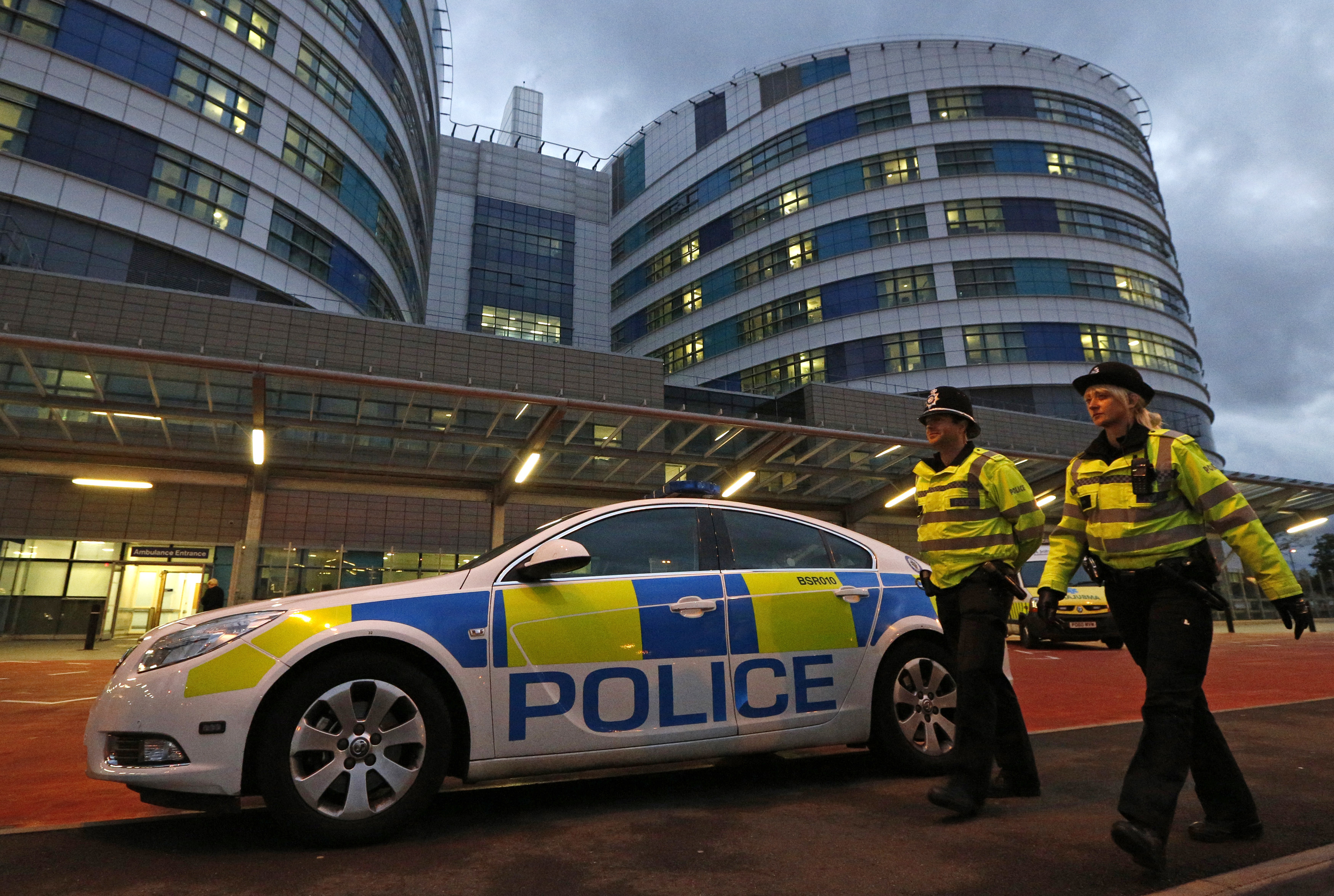 Police officers patrol outside the emergency entrance of the Queen Elizabeth Hospital where injured Pakistani teenager Malala Yousufzai arrived for treatment in Birmingham, central England October 15, 2012. A Pakistani schoolgirl shot in the head by