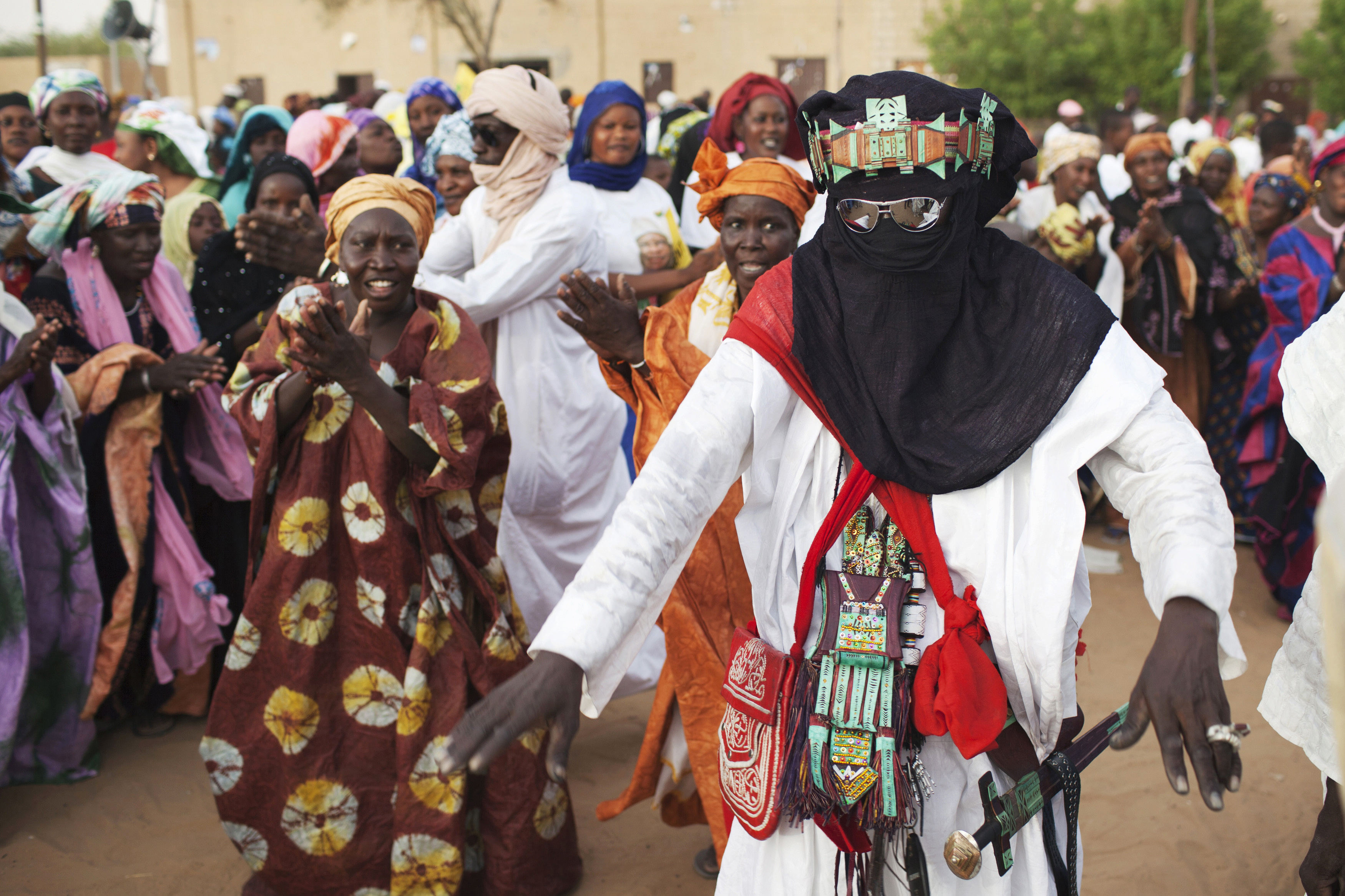 A Tuareg man dances at a campaign rally for presidential candidate Ibrahim Boubacar Keita in Timbuktu, Mali, July 24, 2013.