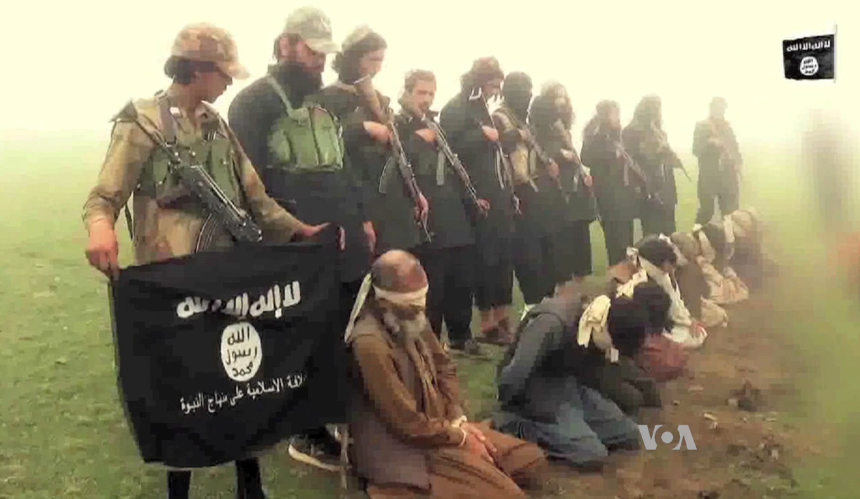 An image from a purported Islamic State group video showing captives.
