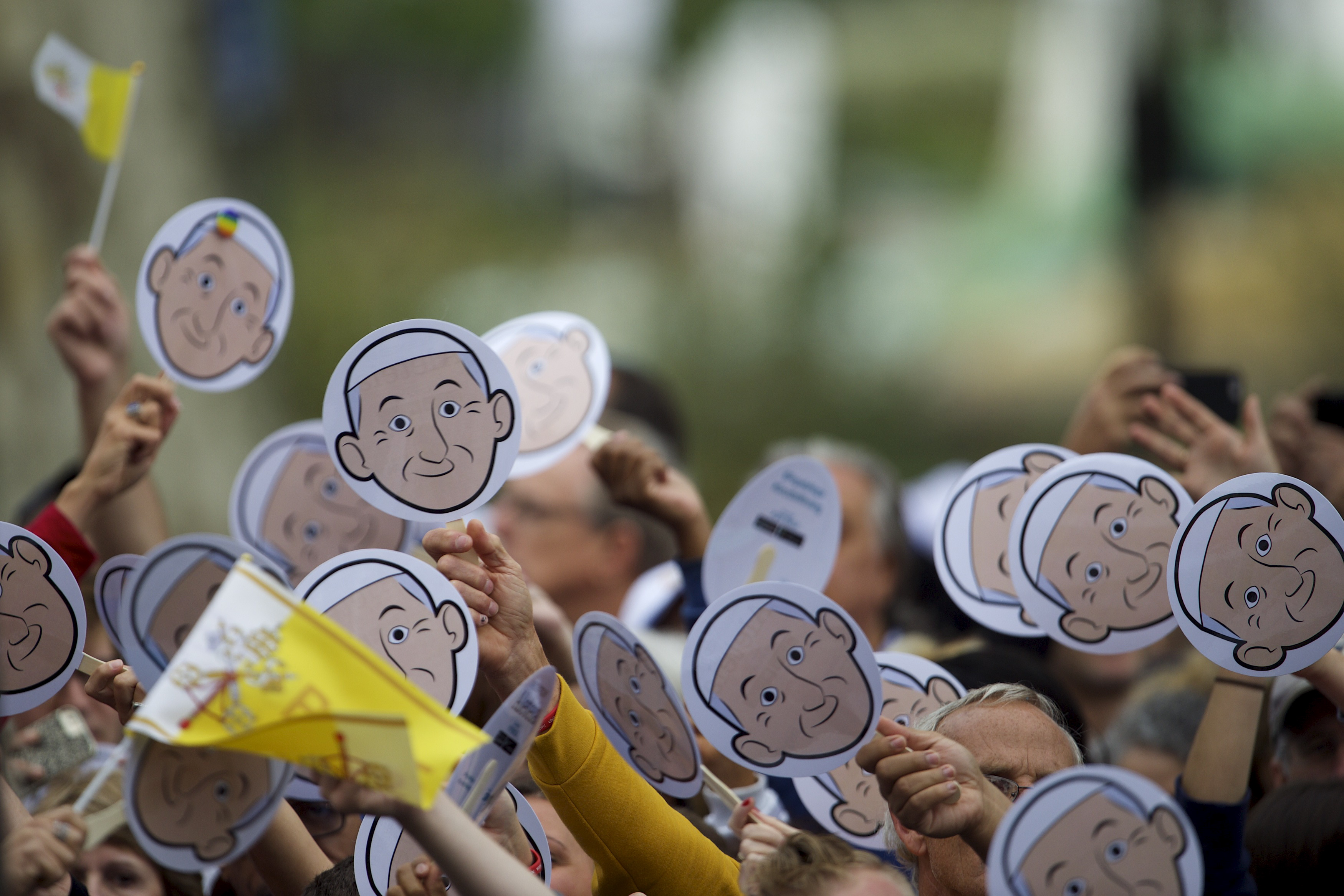 Pilgrims wave cardboard cutouts of Pope Francis before Mass at the Cathedral Basilica of Saints Peter and Paul in Philadelphia, Pennsylvania, Sept. 26, 2015.