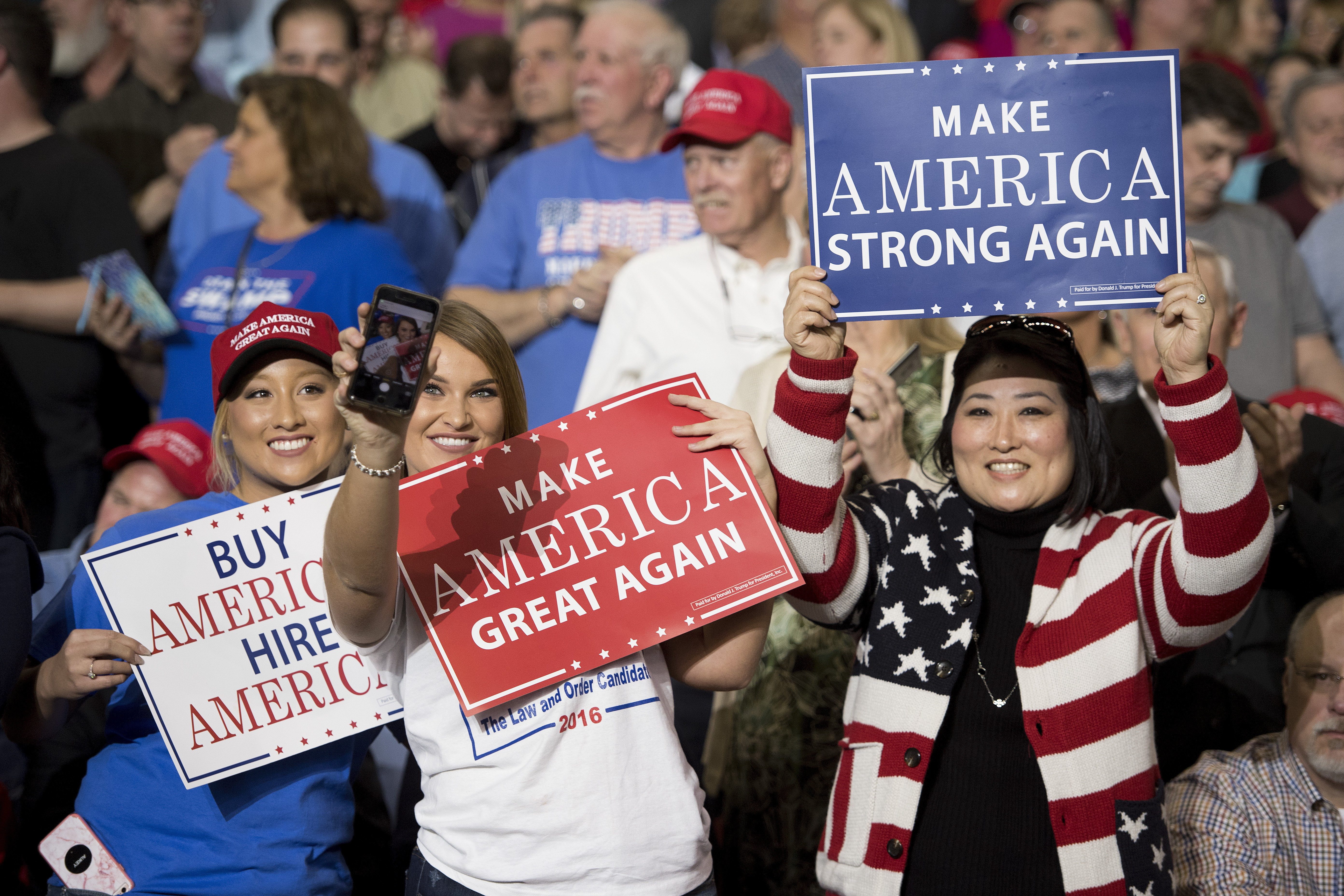 FILE - Supporters take selfies as President Donald Trump arrives at a 'Make America Great Again' rally in Louisville, Kentucky, March 20, 2017.