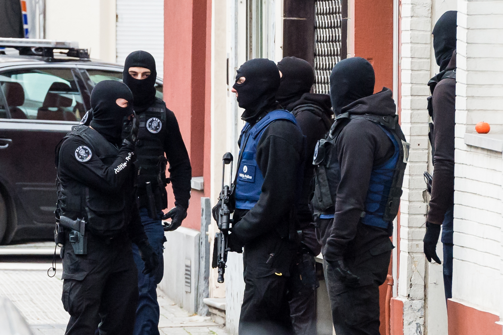 Armed police guard a street in Brussels on Nov. 16, 2015. A major action with heavily armed police is underway in the Brussels neighborhood of Molenbeek amid a manhunt for a suspect of the Paris attacks.