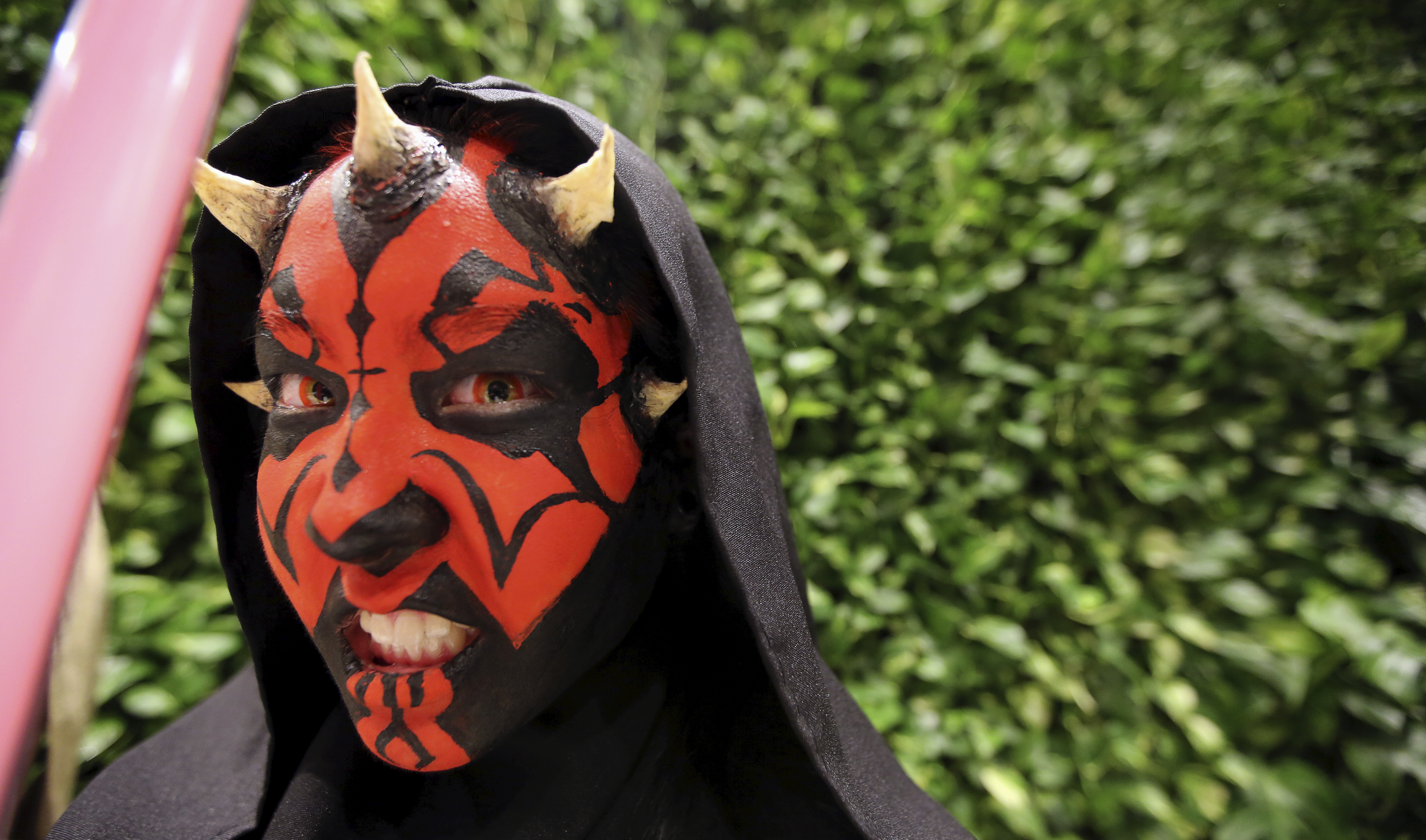 """A woman dressed as the character Darth Maul attends the rollout of products in advancement of the film """"Star Wars: The Force Awakens"""" on """"Force Friday"""" in Sao Paulo, Brazil, Sept. 4, 2015."""