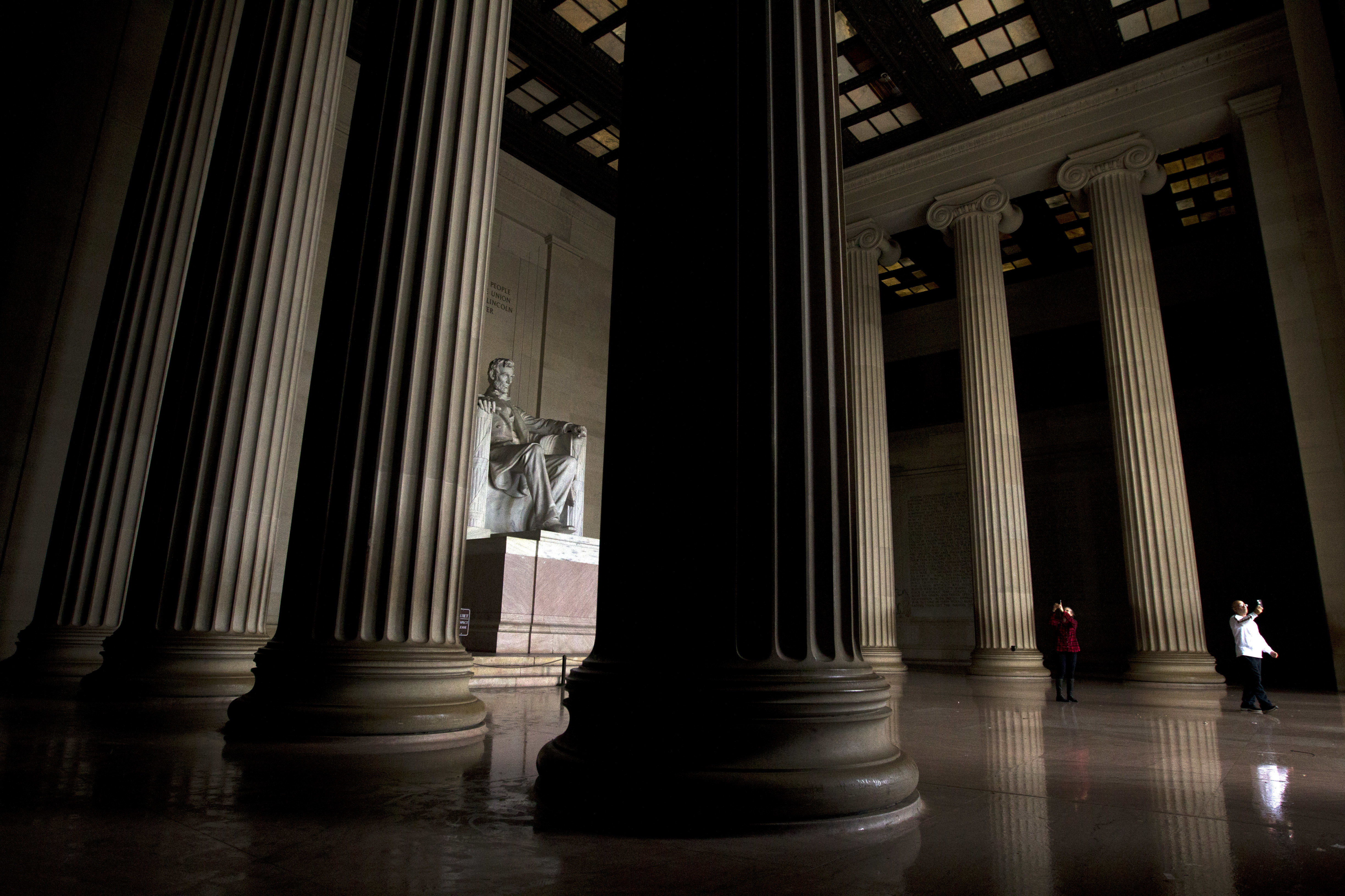 Visitors take their pictures at the Lincoln Memorial in Washington, Tuesday, Jan. 1, 2019, as a partial government shutdown stretches into its third week.